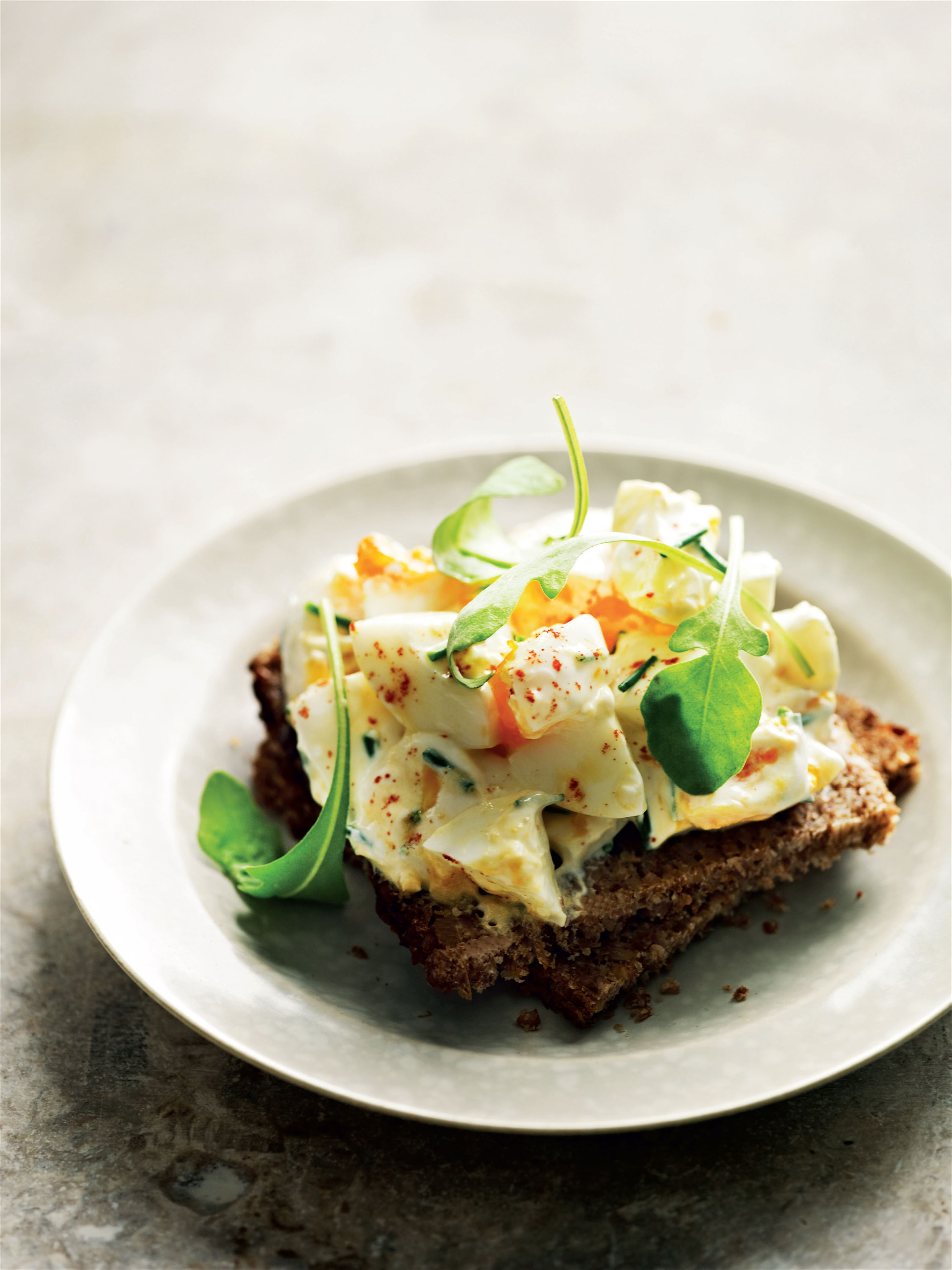 Creamy egg and rye decker with wild rocket