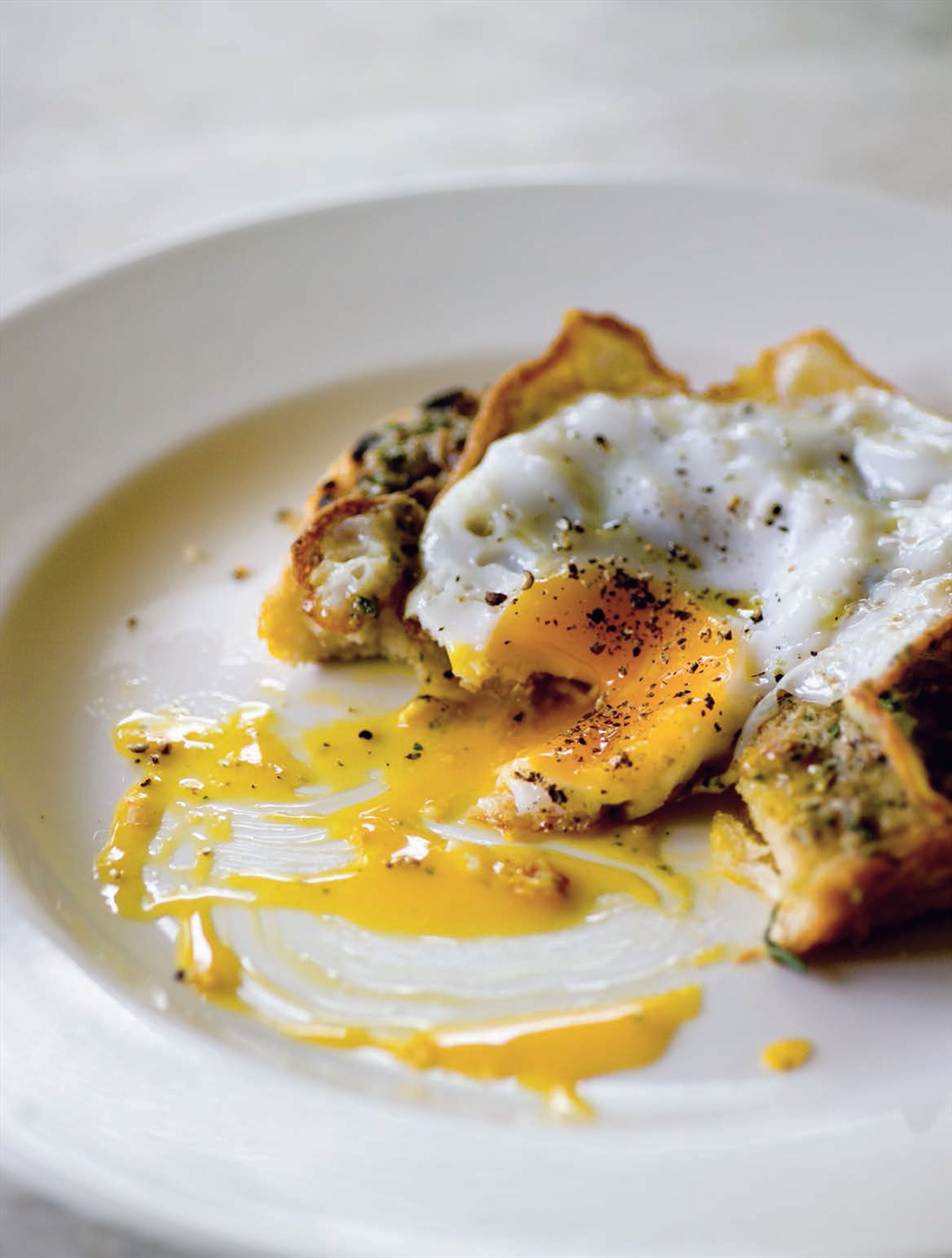 Anchovy toast with fried duck egg