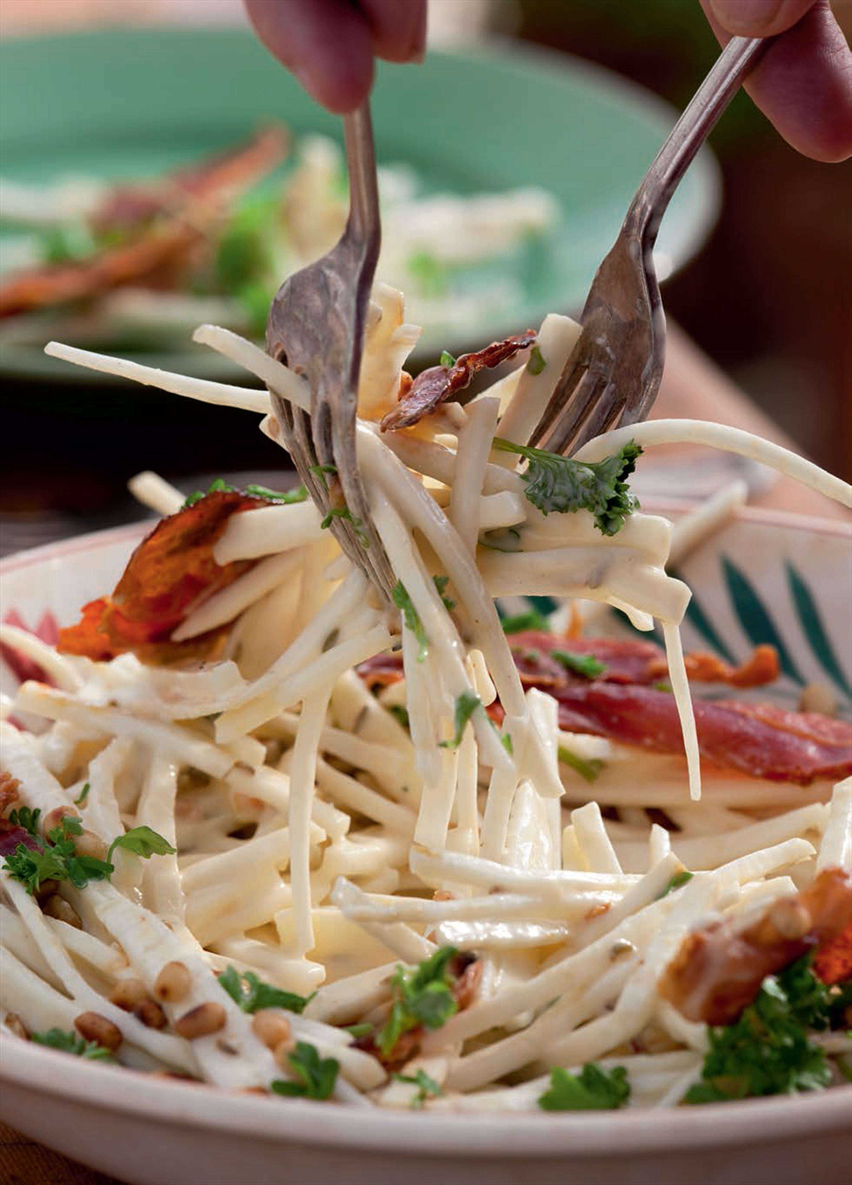 Celeriac salad with apple, pine nuts and prosciutto