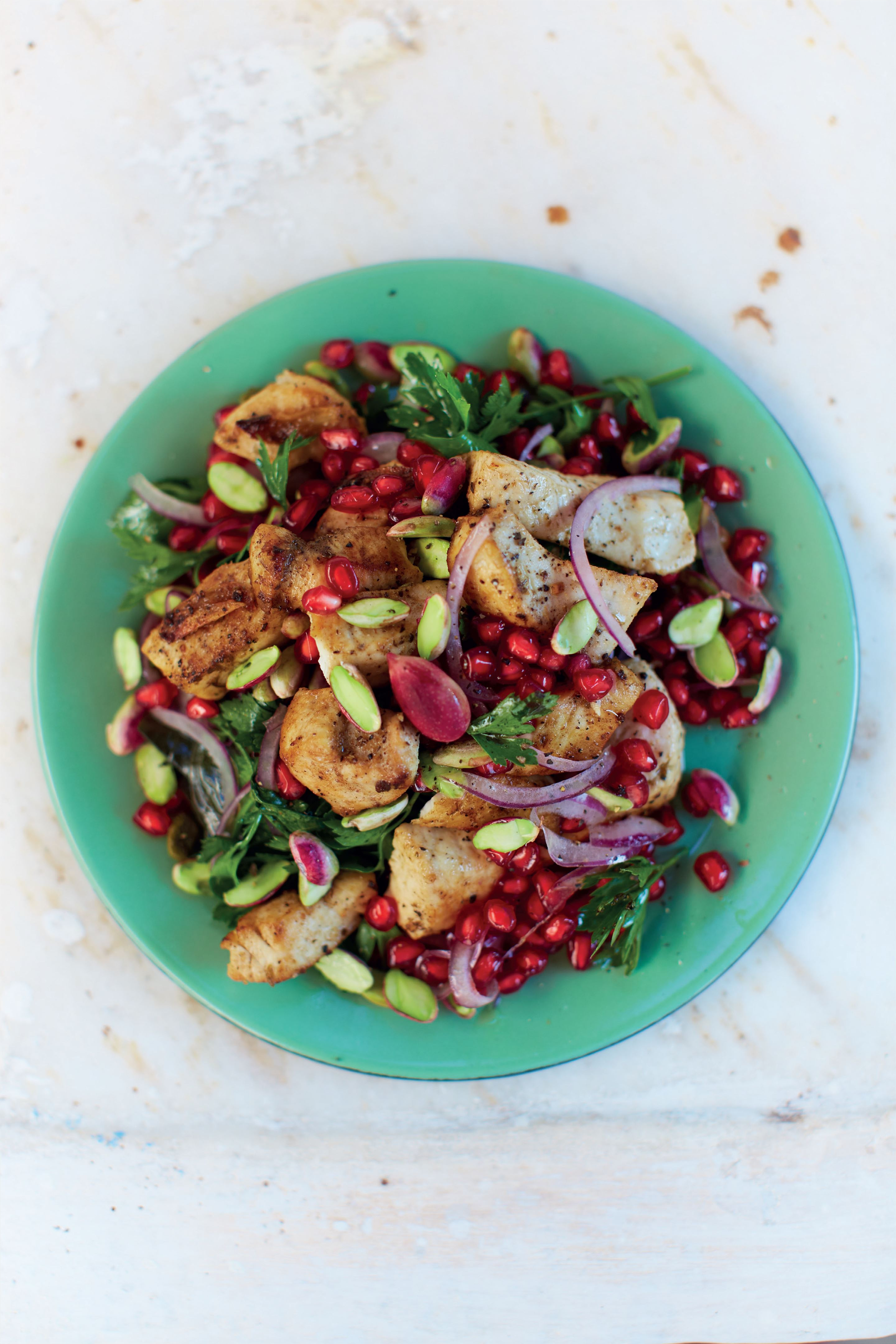 Swordfish with pomegranate, onion and pistachio salad