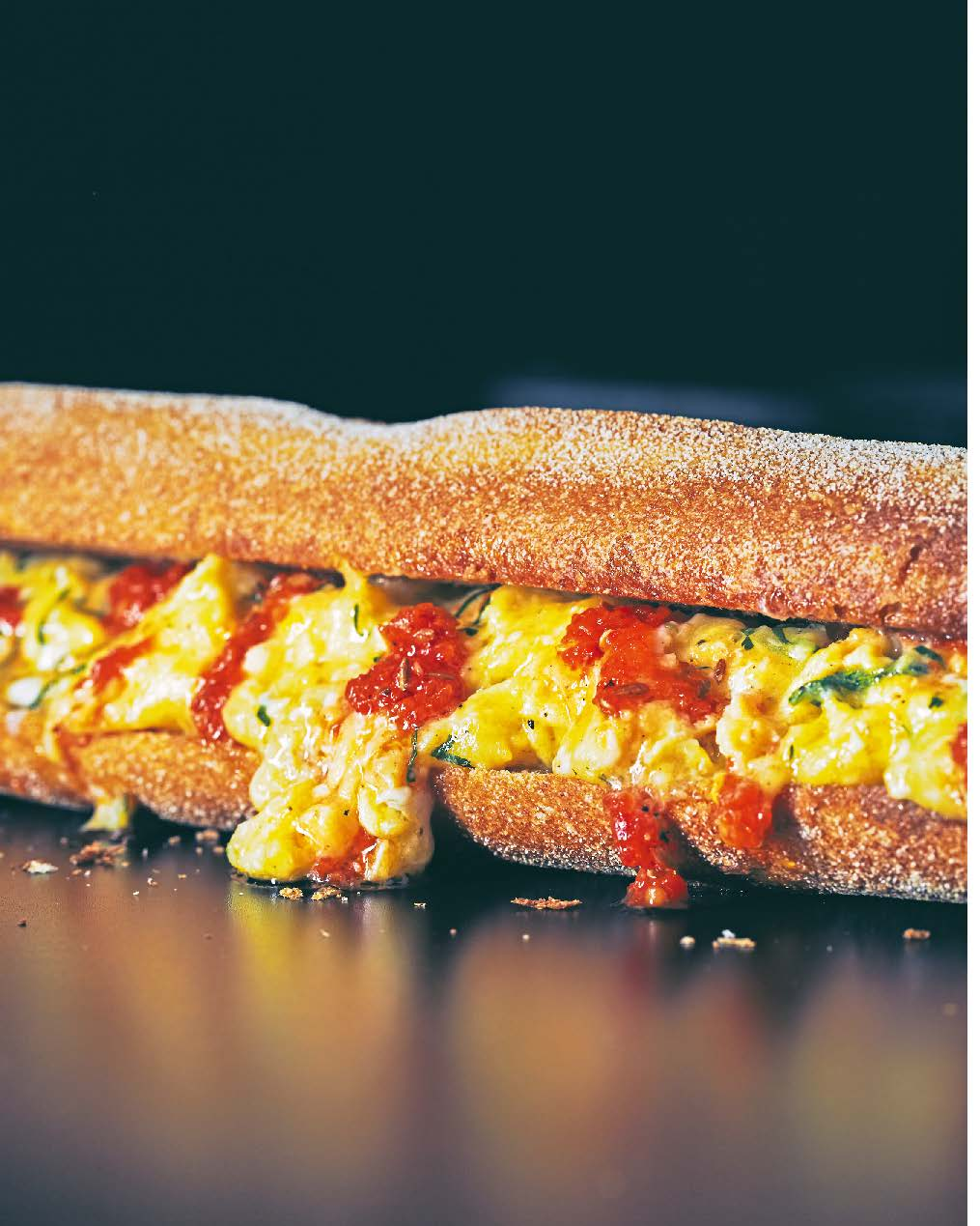 Toasted baguette with scrambled egg + harissa