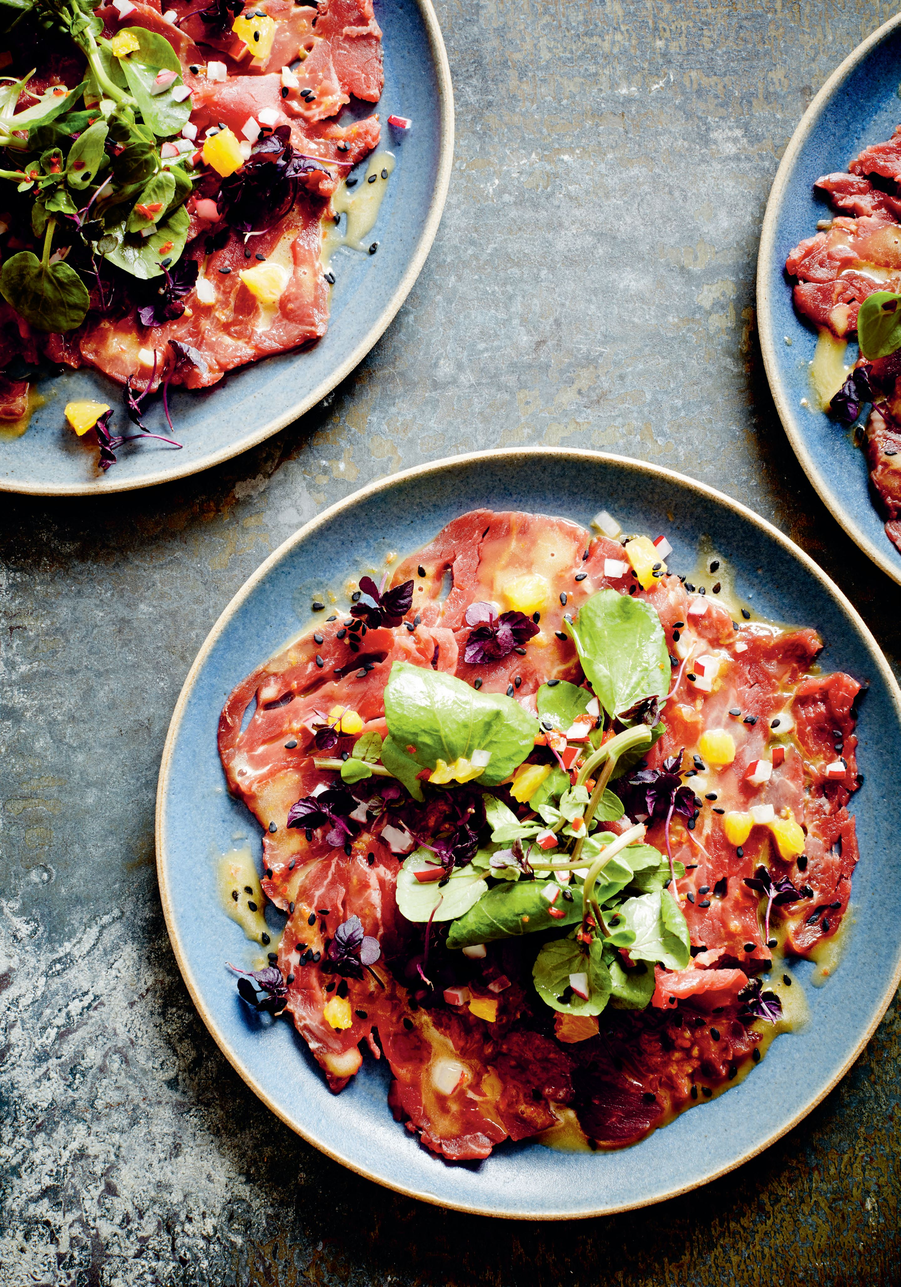 Beef carpaccio salad with lemon-mandarin-kosho dressing