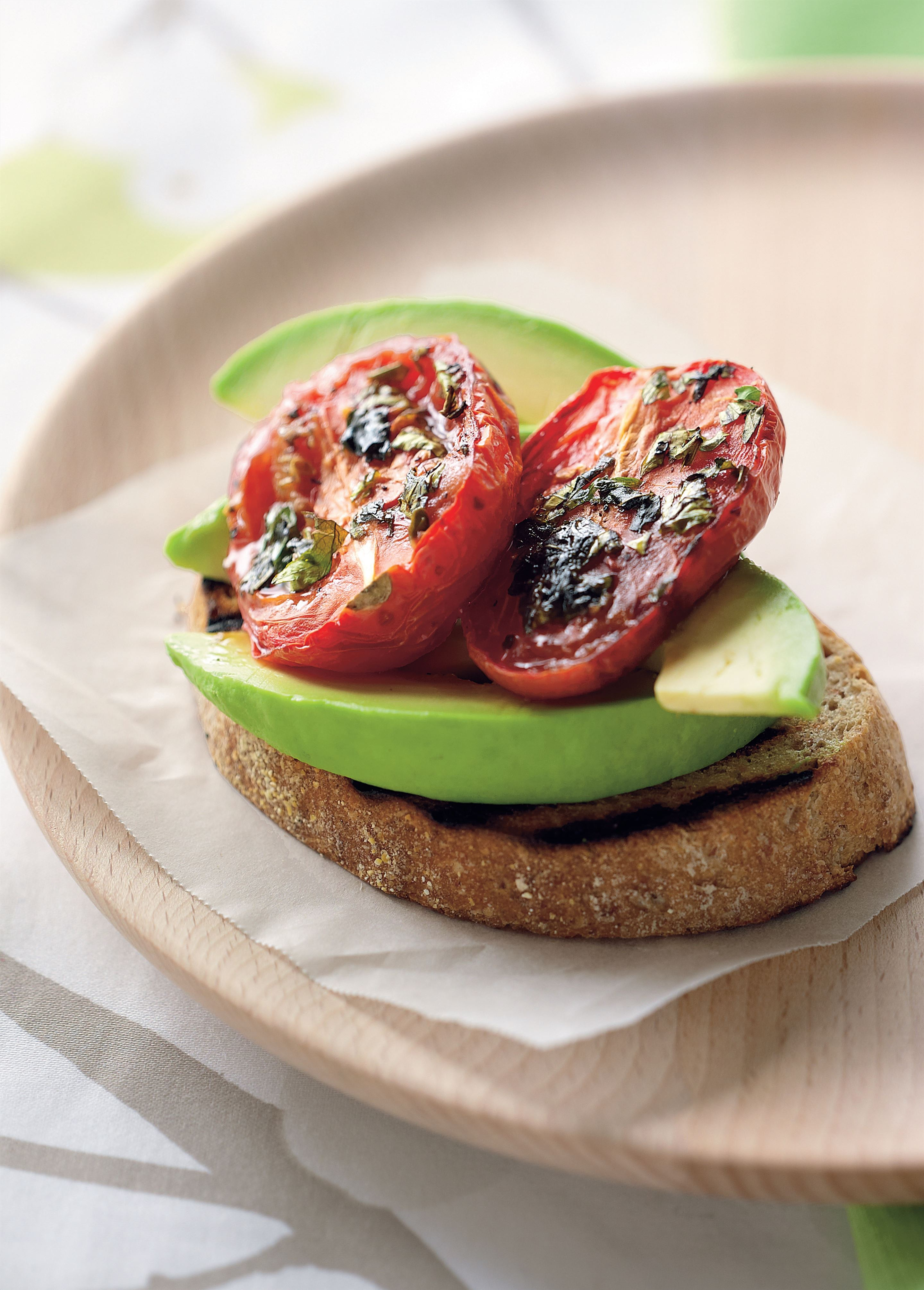 Avocado and roasted tomato on toast