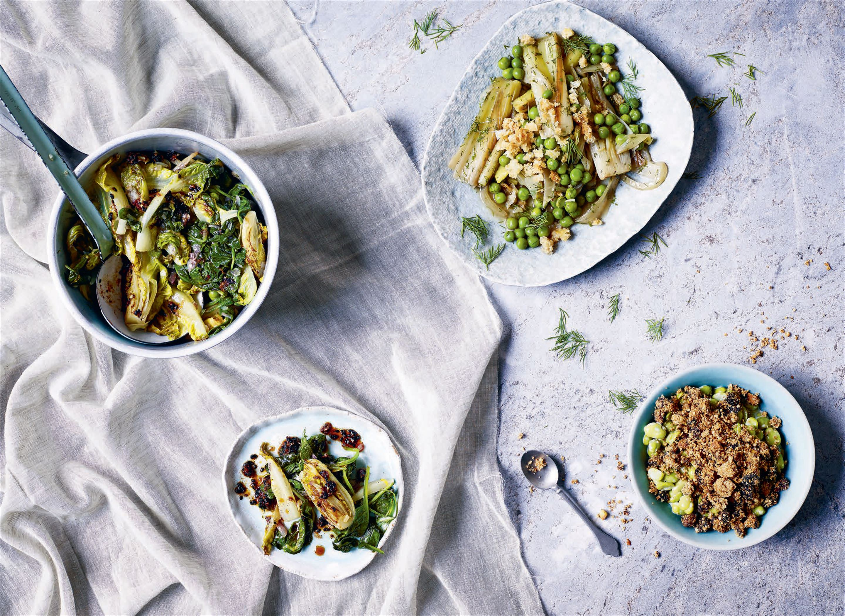 Broad beans with sultana and pistachio crumble