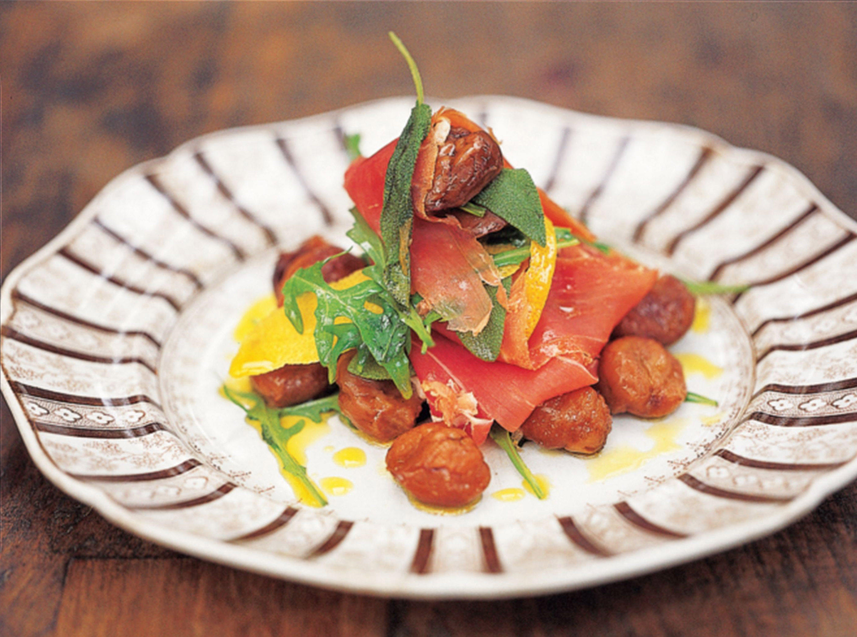 Parma ham with warm chestnuts, rocket and sage oil