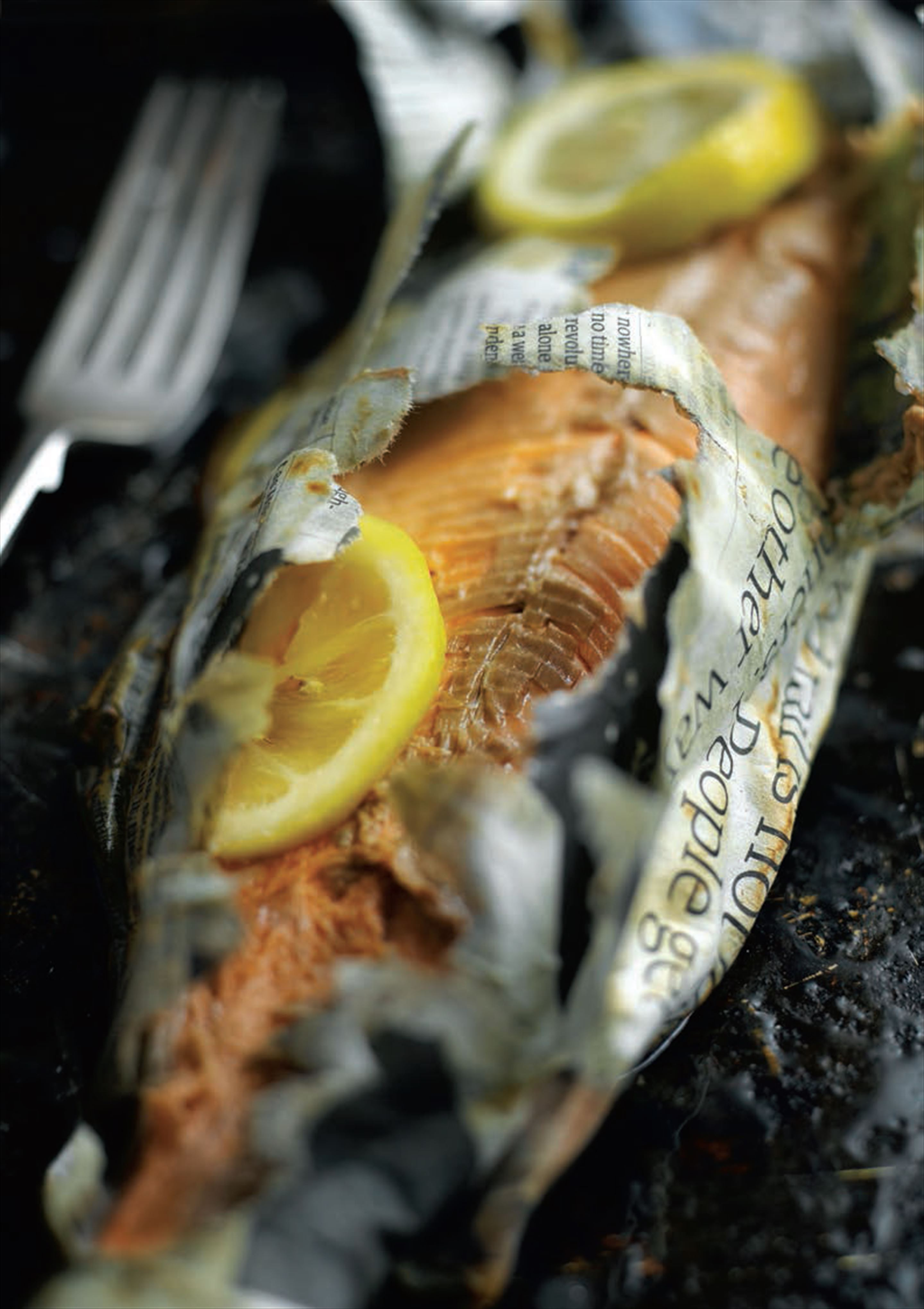 Newspaper-wrapped trout with lemon butter