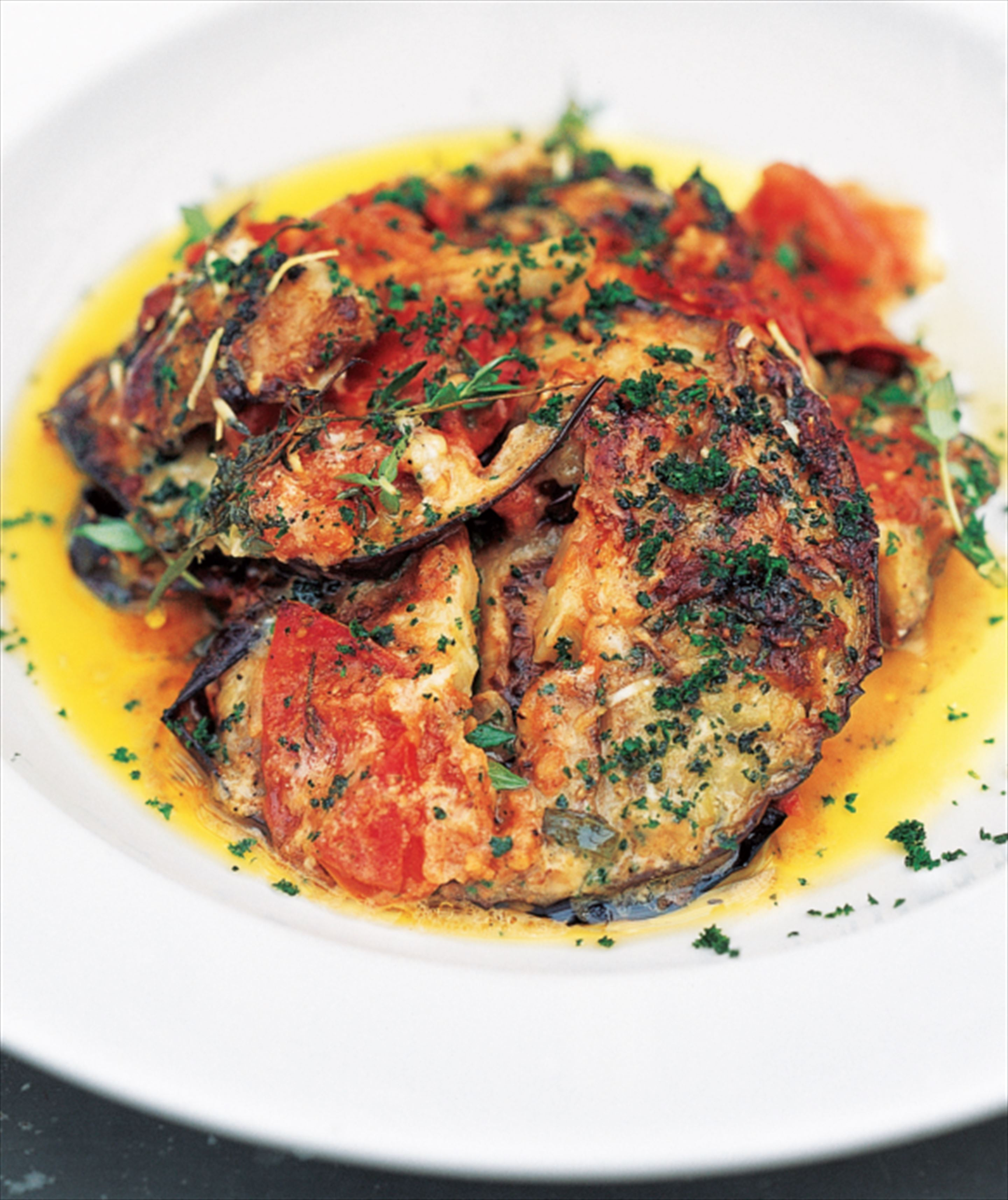 Baked aubergines with tomatoes, tarragon and crème fraîche
