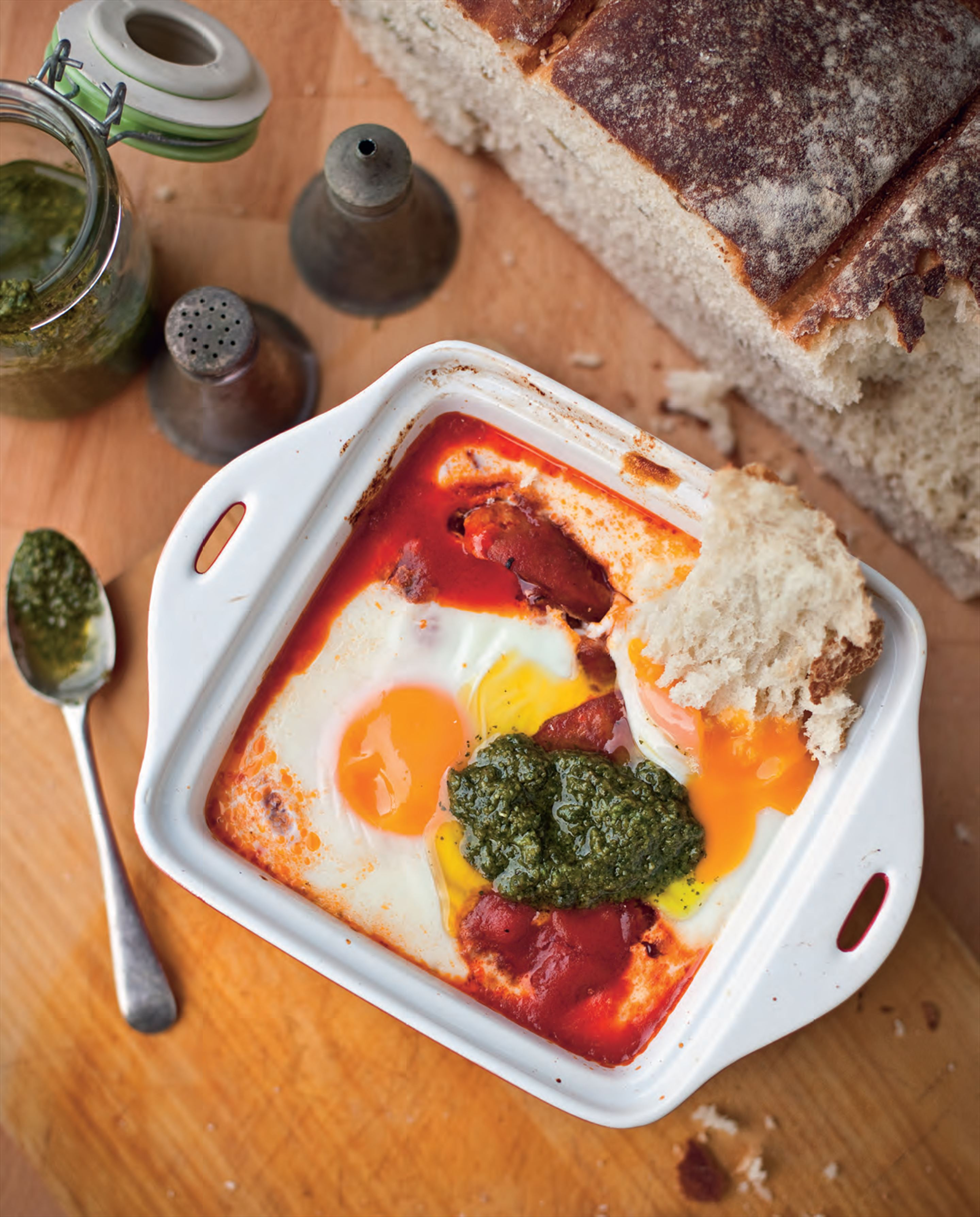 Baked eggs with chorizo, potatoes and basil pesto