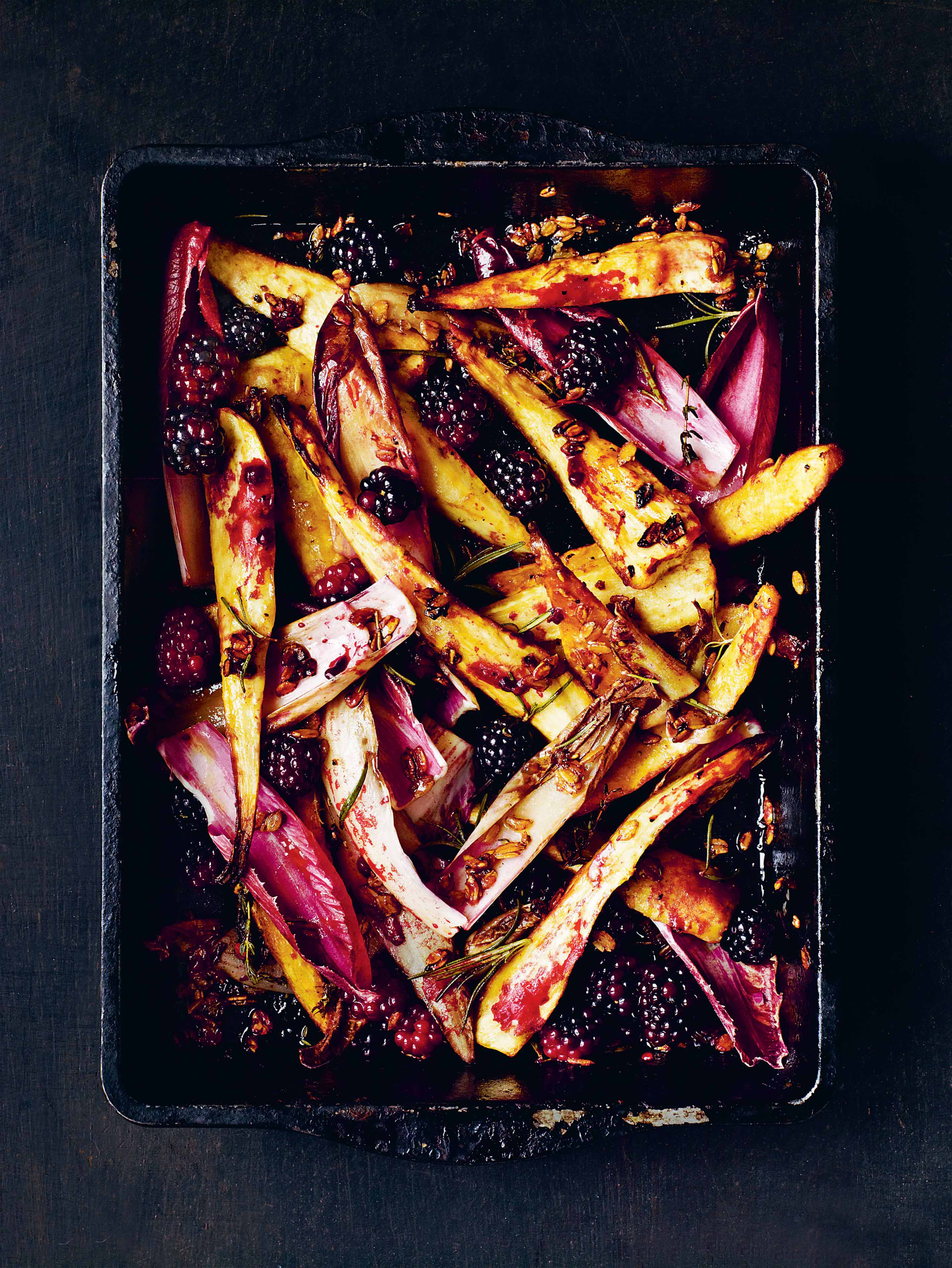 Roast parsnips with blackberries, honey chicory & rye flakes