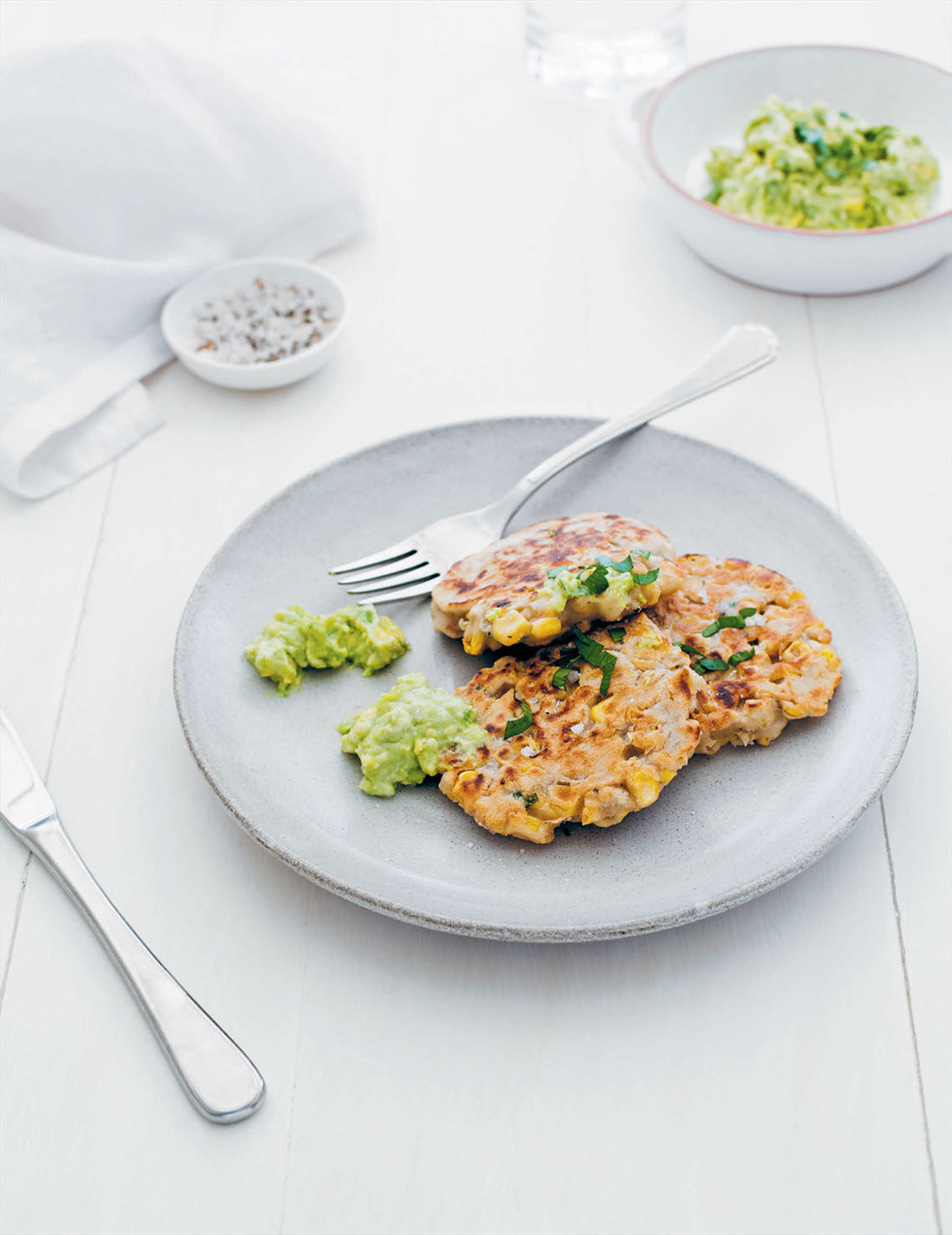 Corn fritters with avocado and 'goat's' cheeses mash