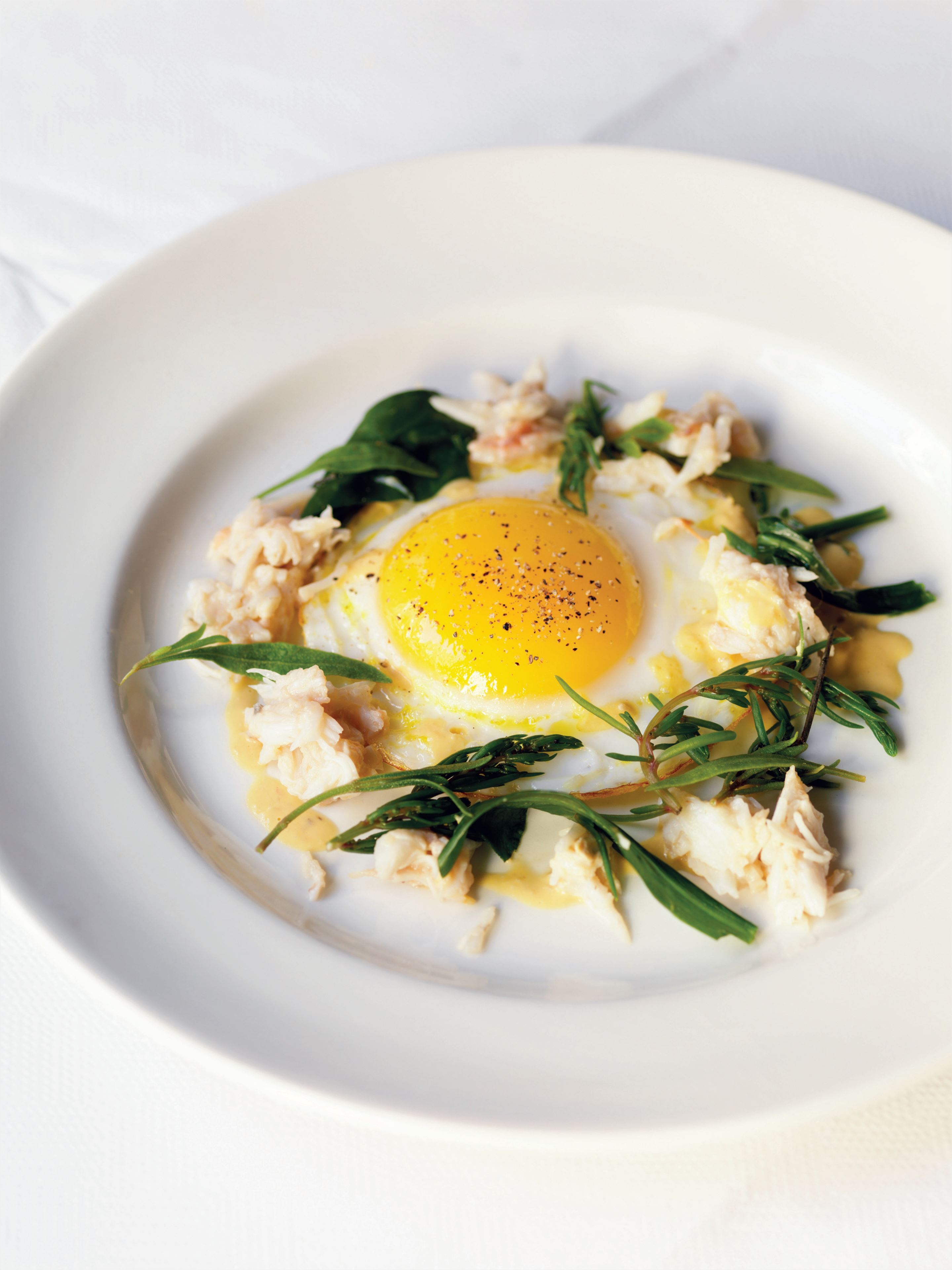 Fried duck's egg with spider crab and sea greens