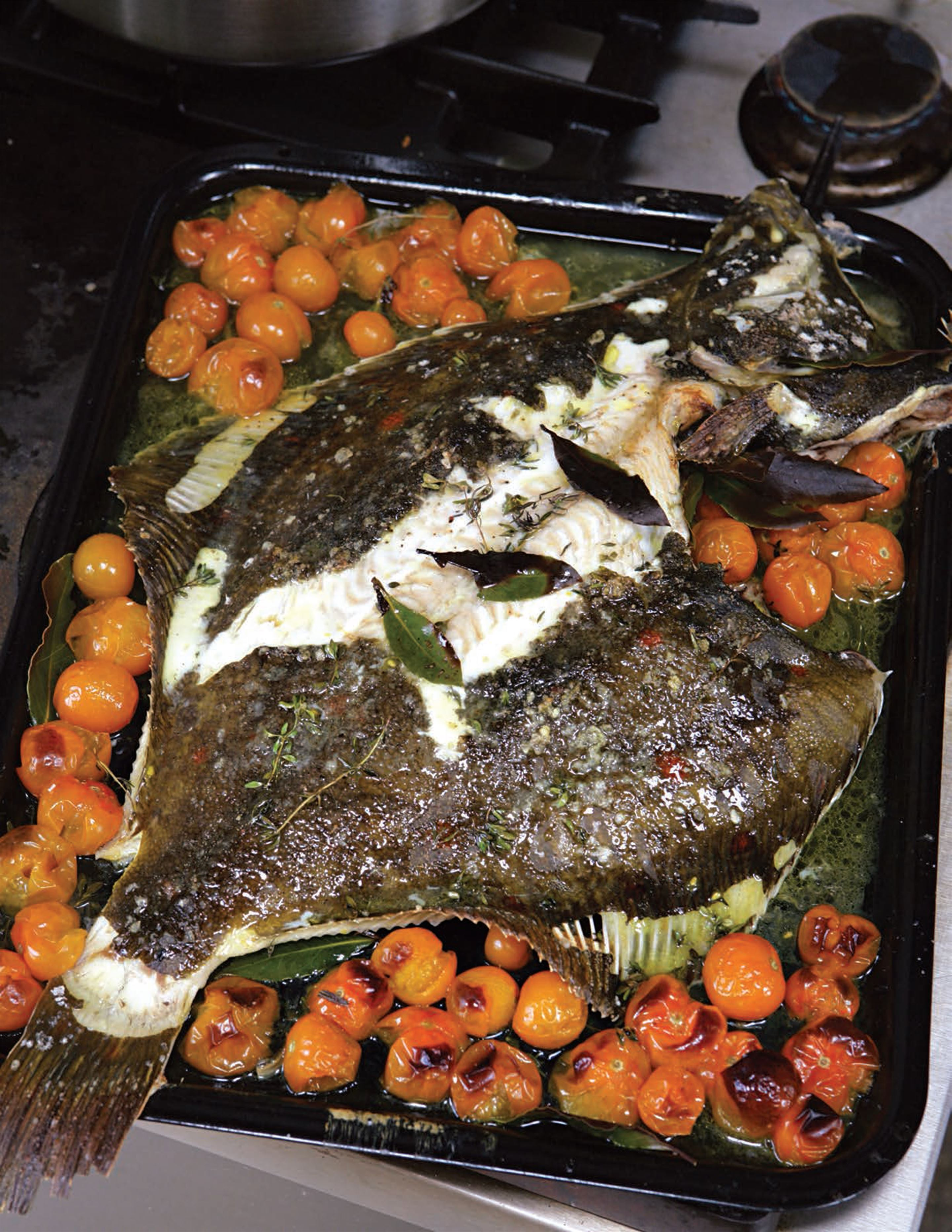 Roasted whole plaice with cherry tomatoes