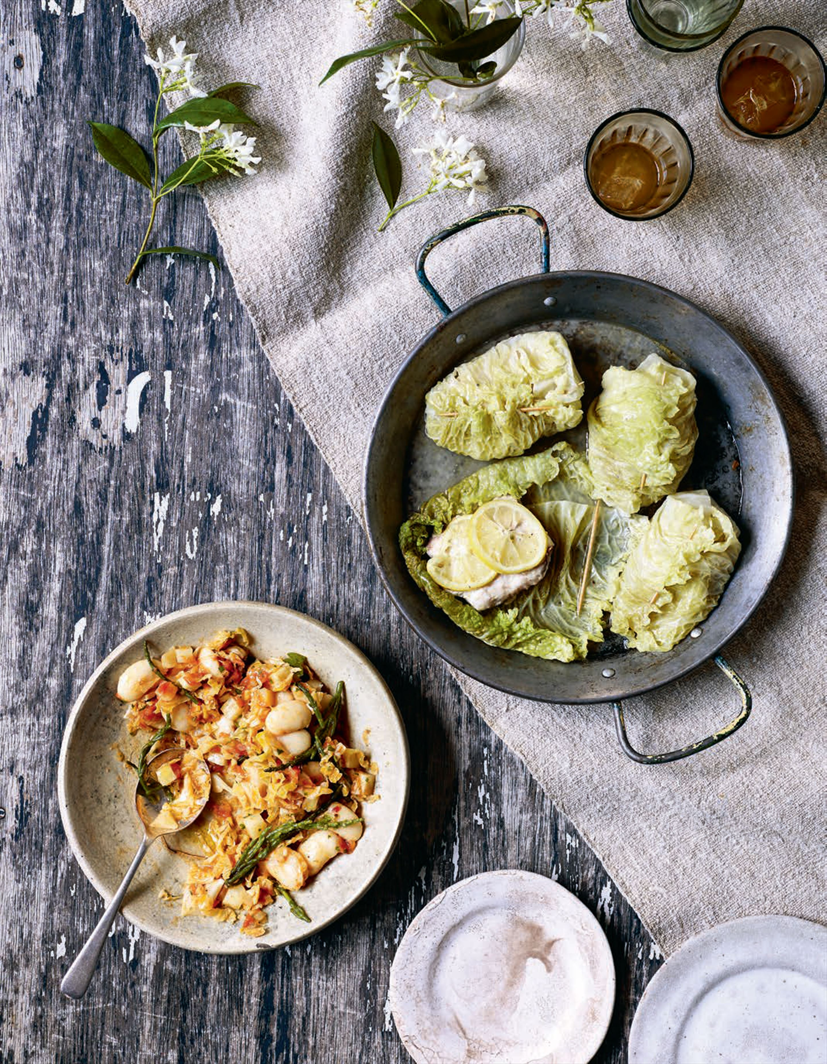 Savoy cabbage and snapper parcels with braised butter beans