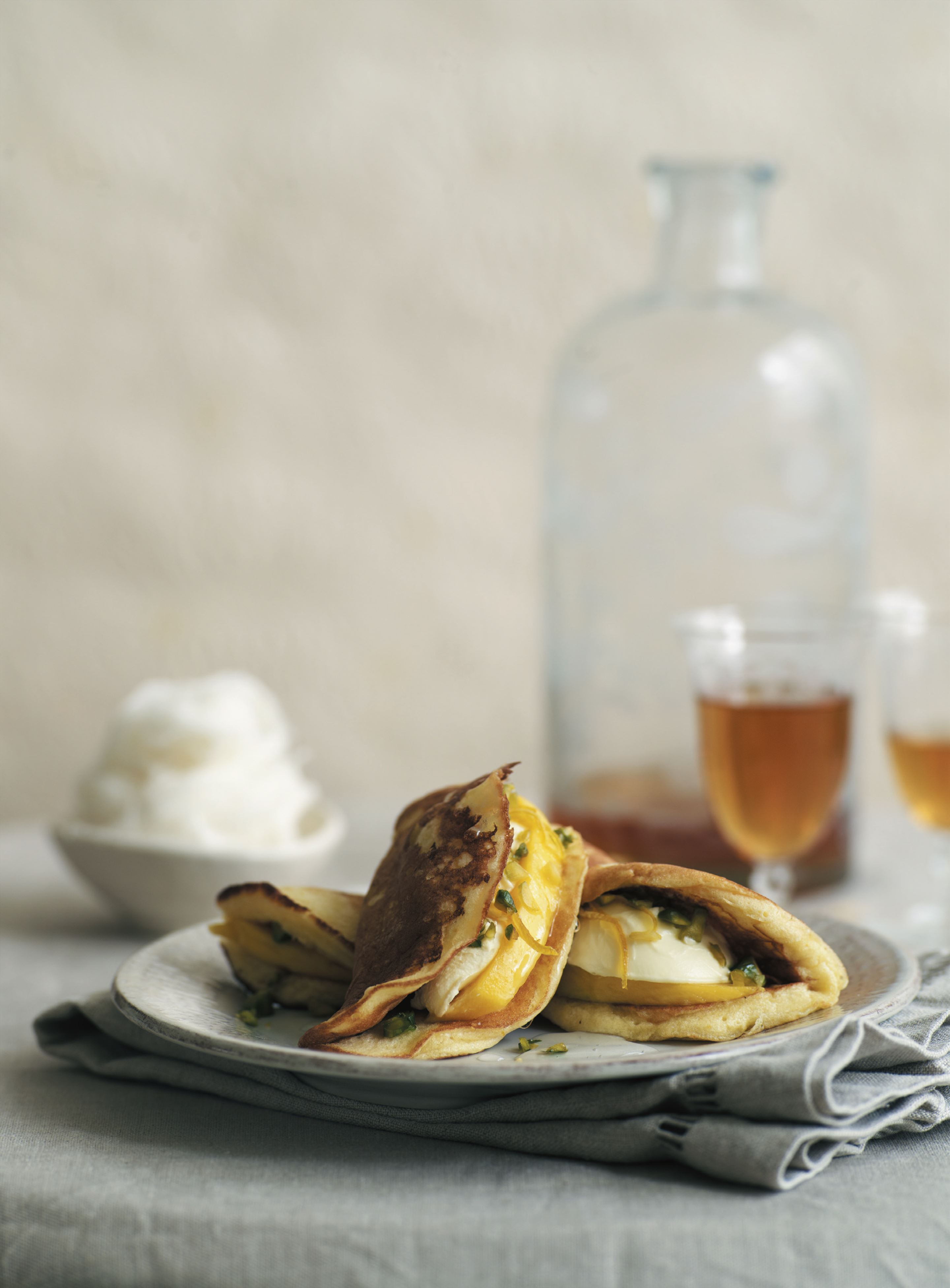 Arabic pancakes with fresh mangoes and orange-blossom clotted cream