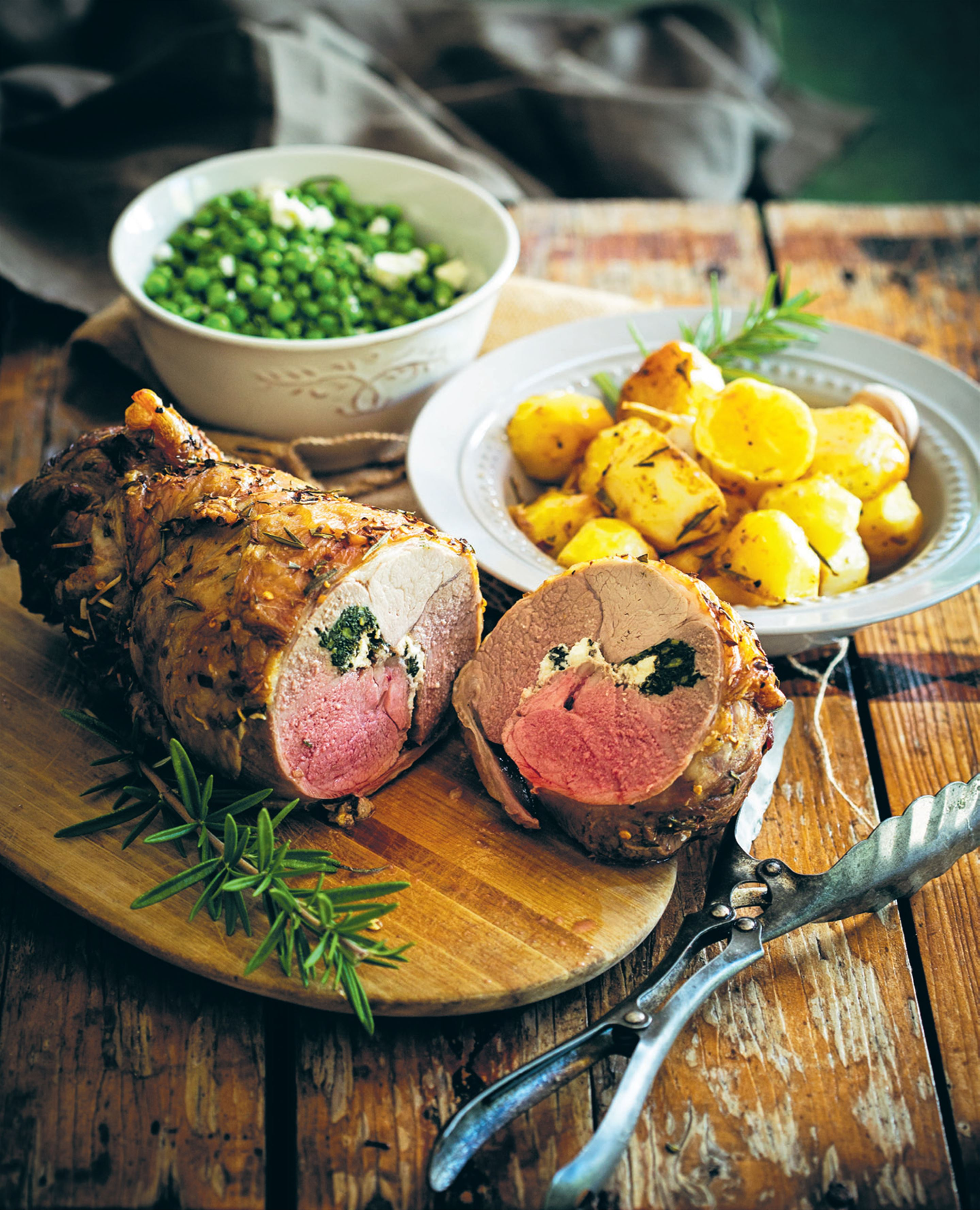 Kale and feta stuffed roast leg of lamb