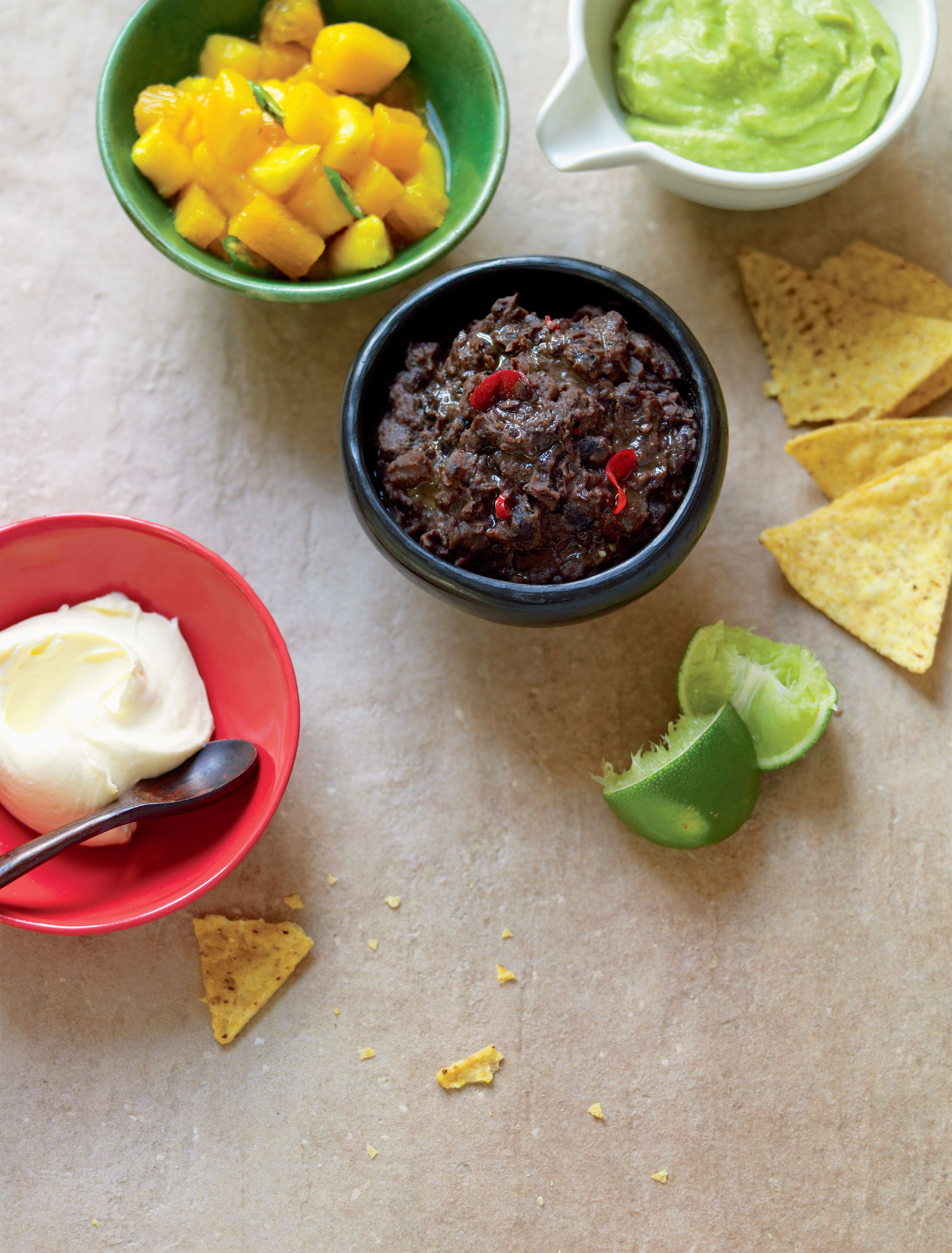 Black beans with mango salsa, tofu sour cream and avocado dip