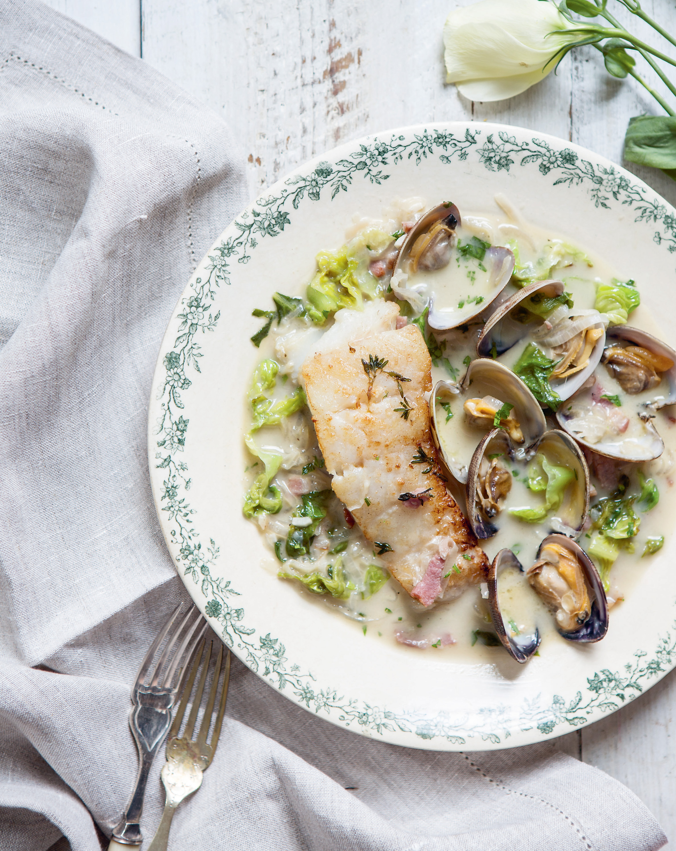 Pan-roasted pollock with lettuce, bacon + clams