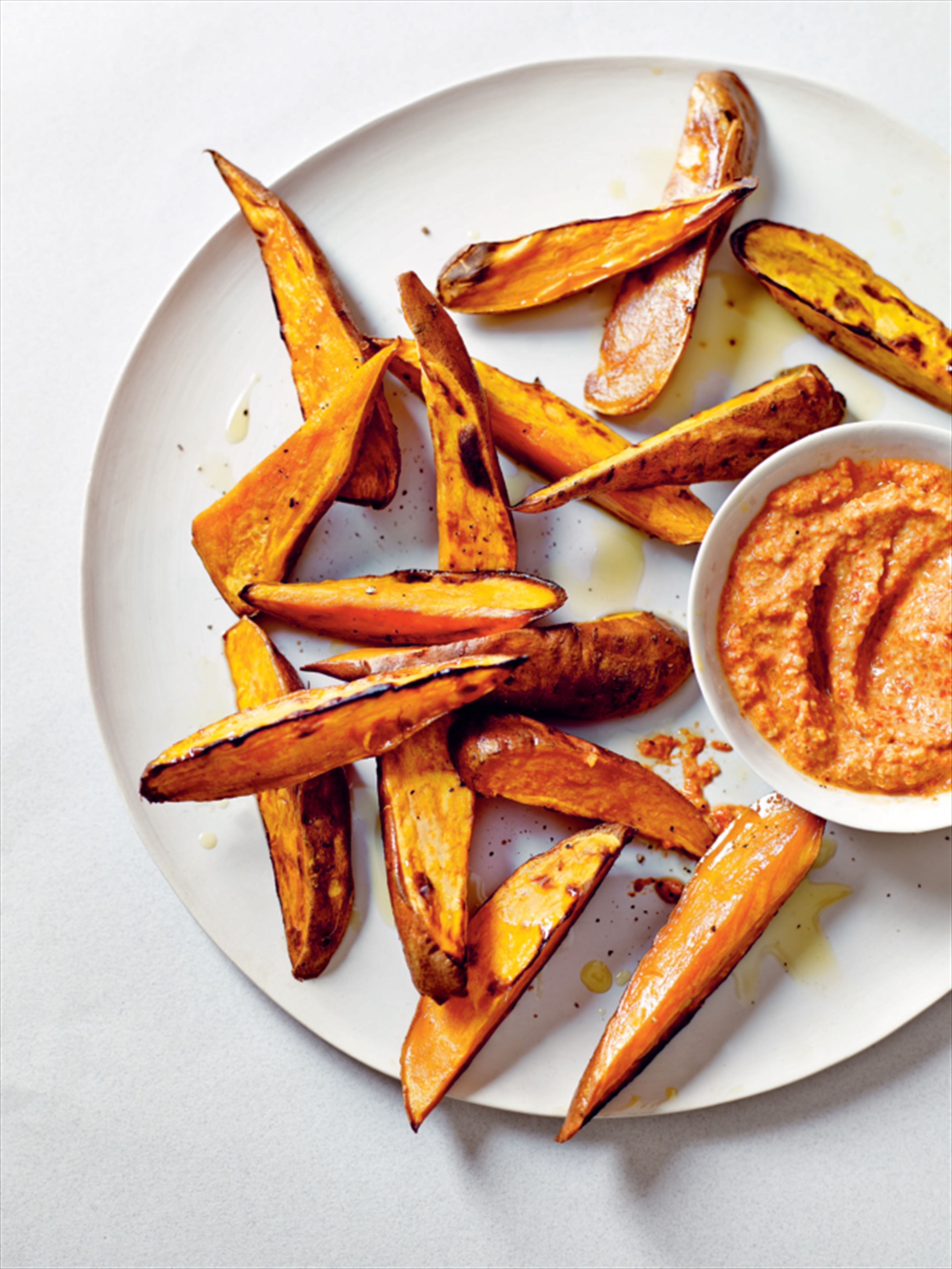 Sweet potato wedges with red pepper-walnut dip