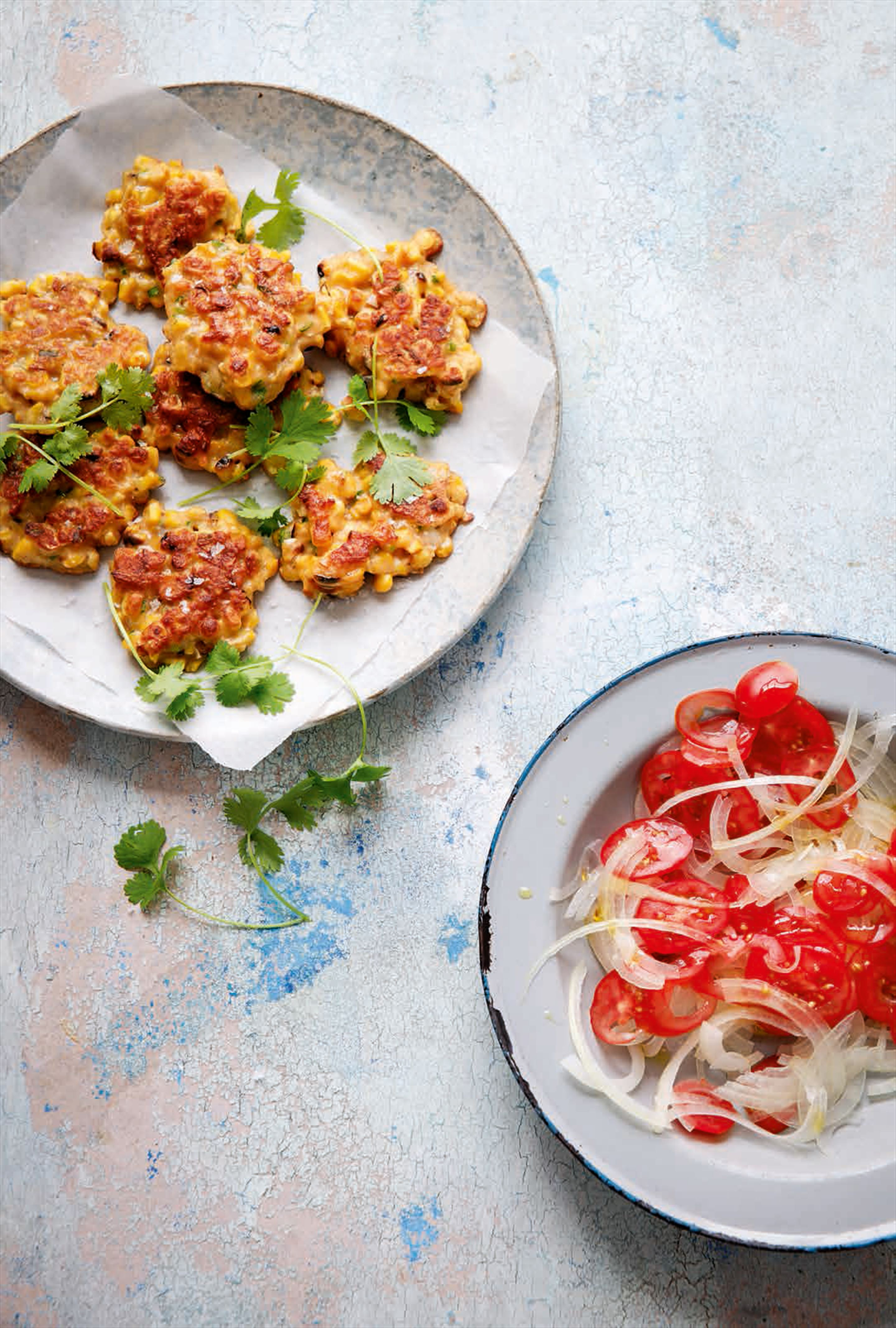 Sweetcorn fritters with tomato & onion salad