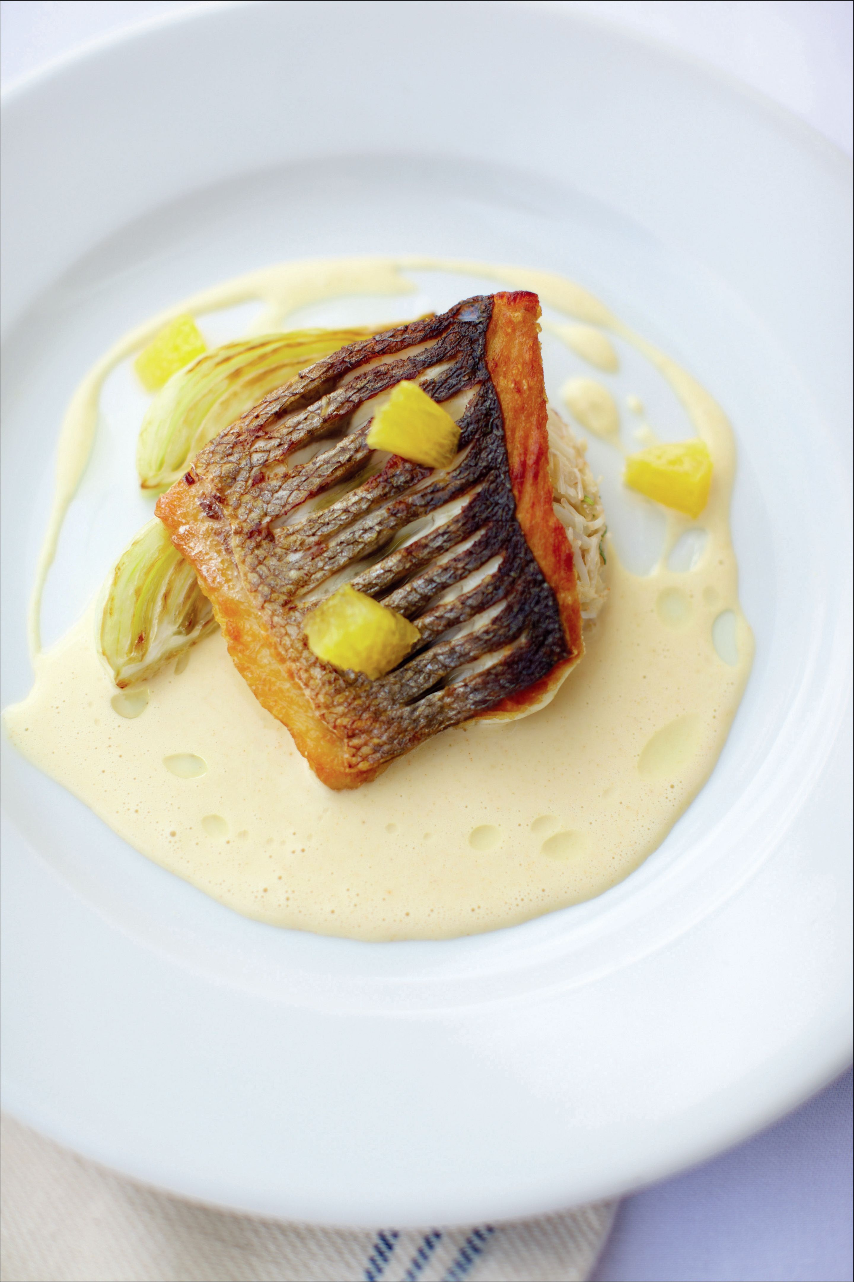 Sea bass with crab mayonnaise, roasted fennel and orange