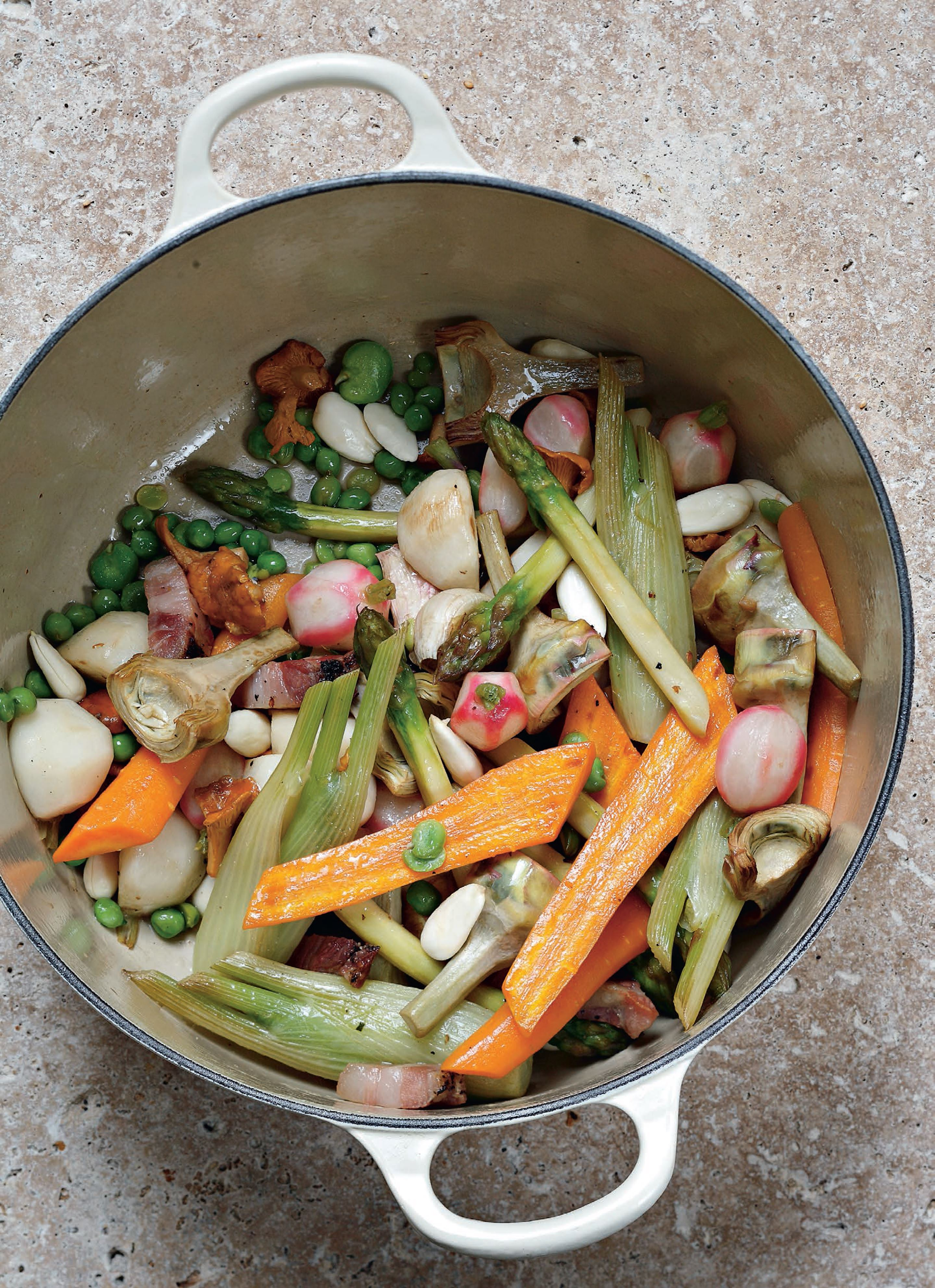Spring and summer vegetables and mushrooms en cocotte