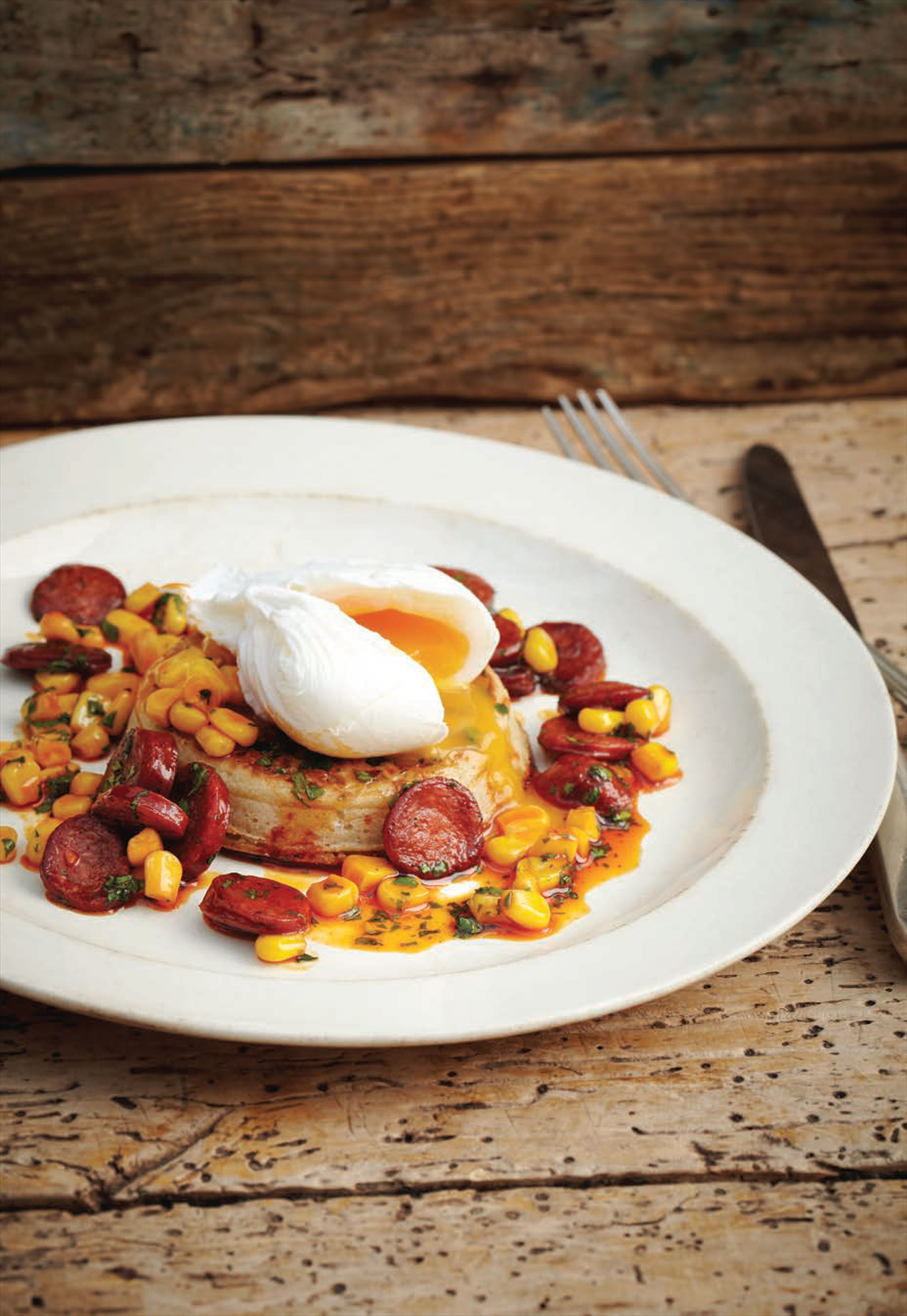 Toasted crumpets with poached eggs, bath pig chorizo and sweetcorn