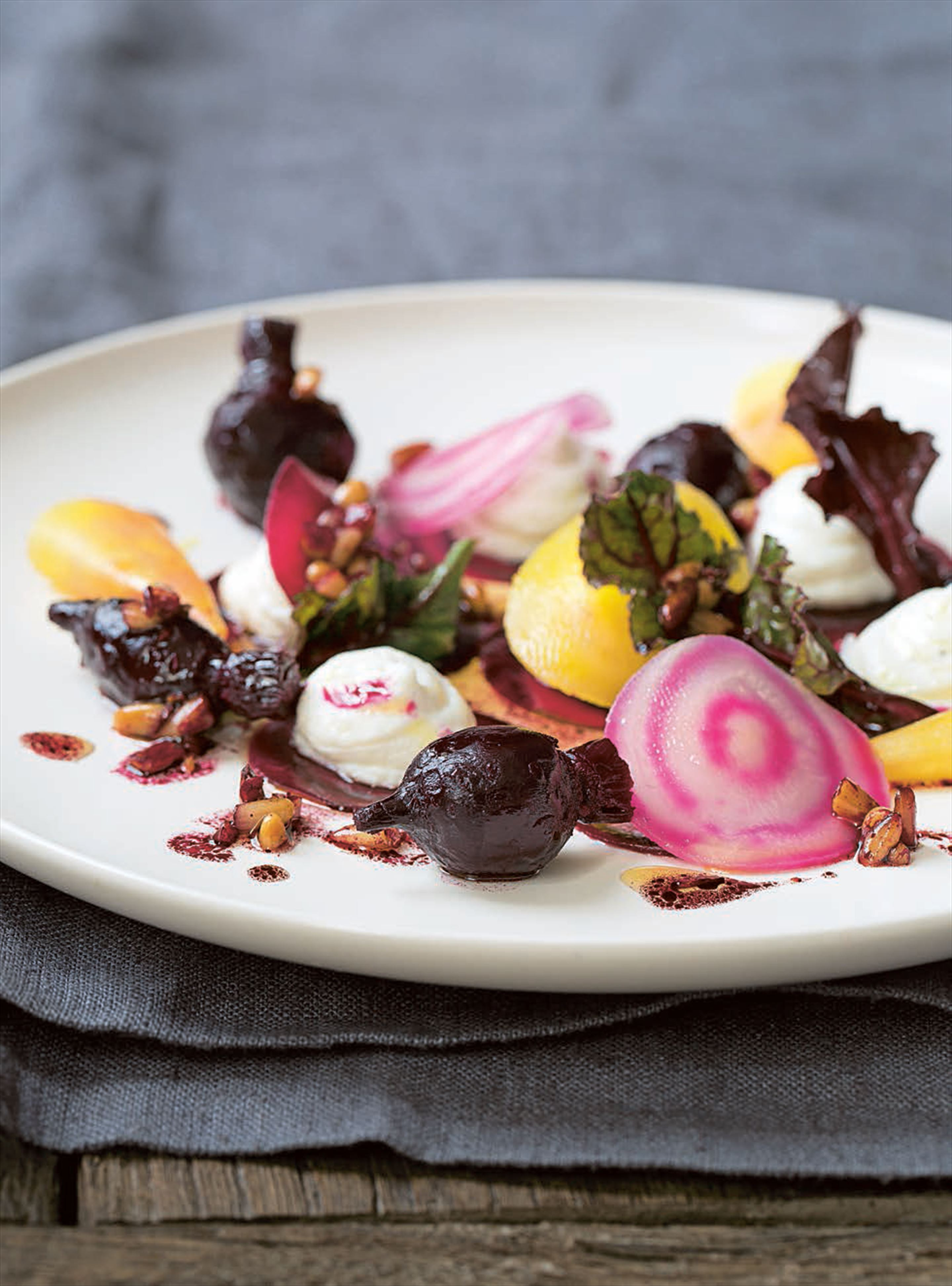 Mixed beetroot salad with goat's cheese mousse and pine nut dressing