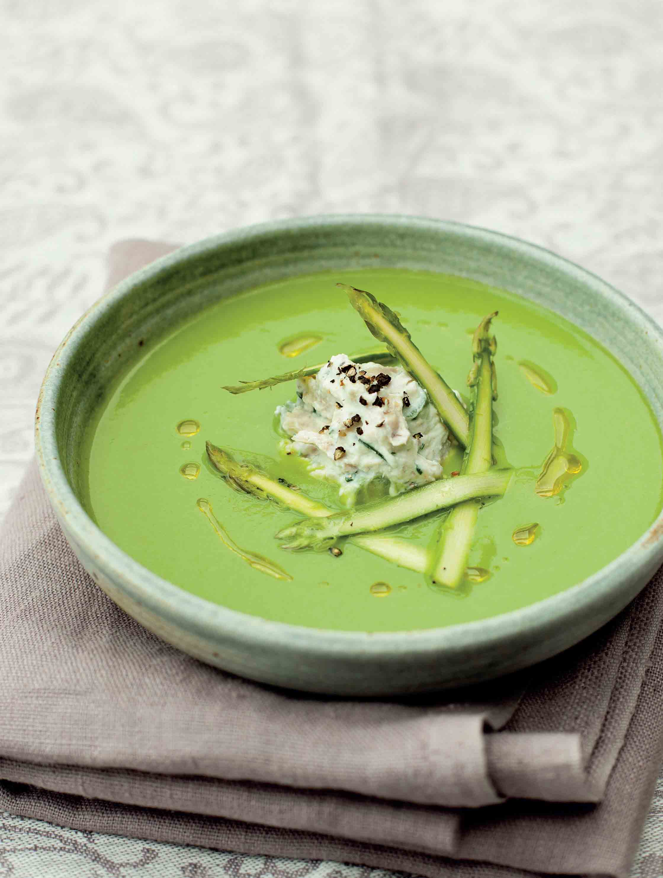 Asparagus soup topped with ricotta, chives and crispy chicken
