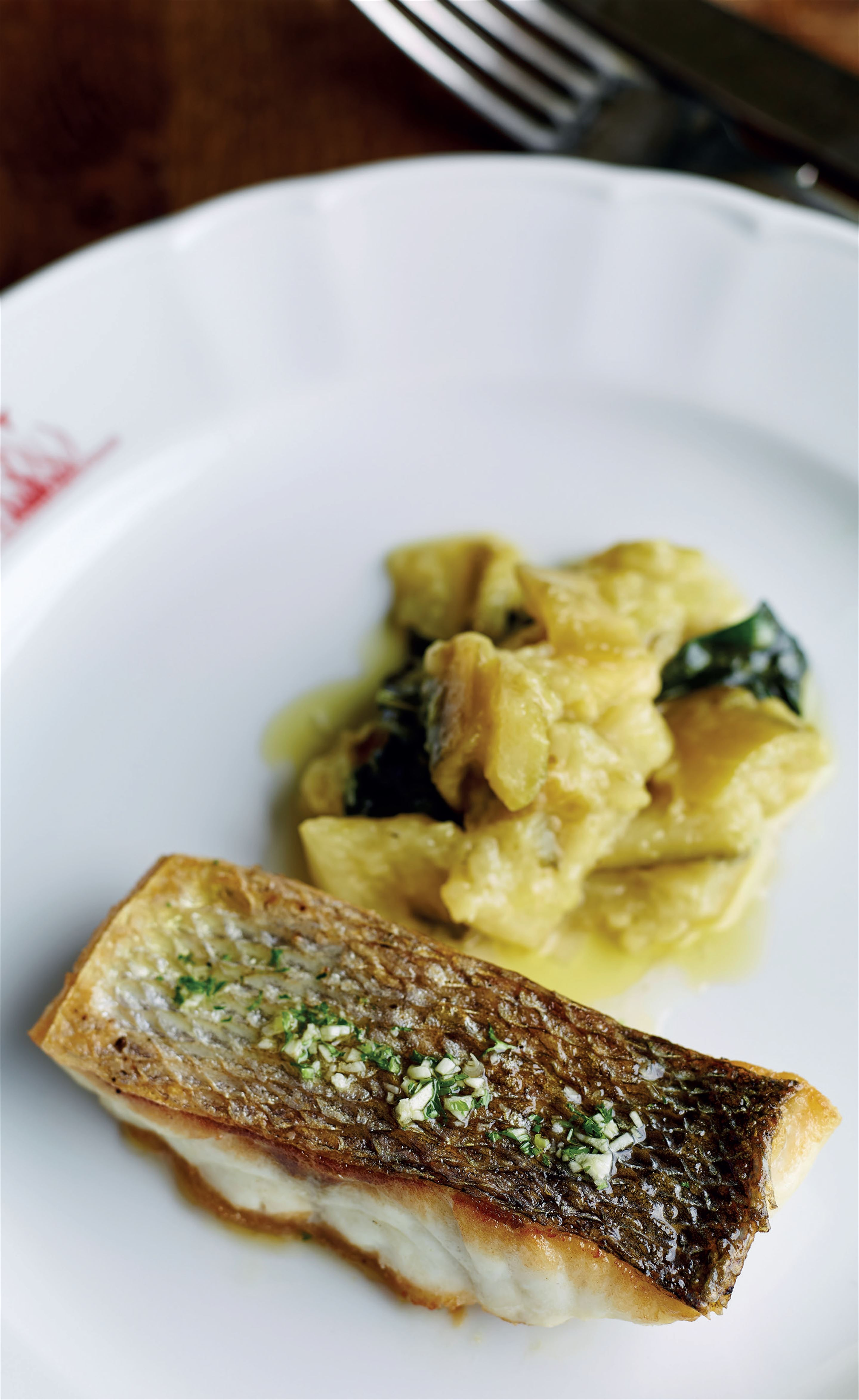 Sea bass with braised courgettes