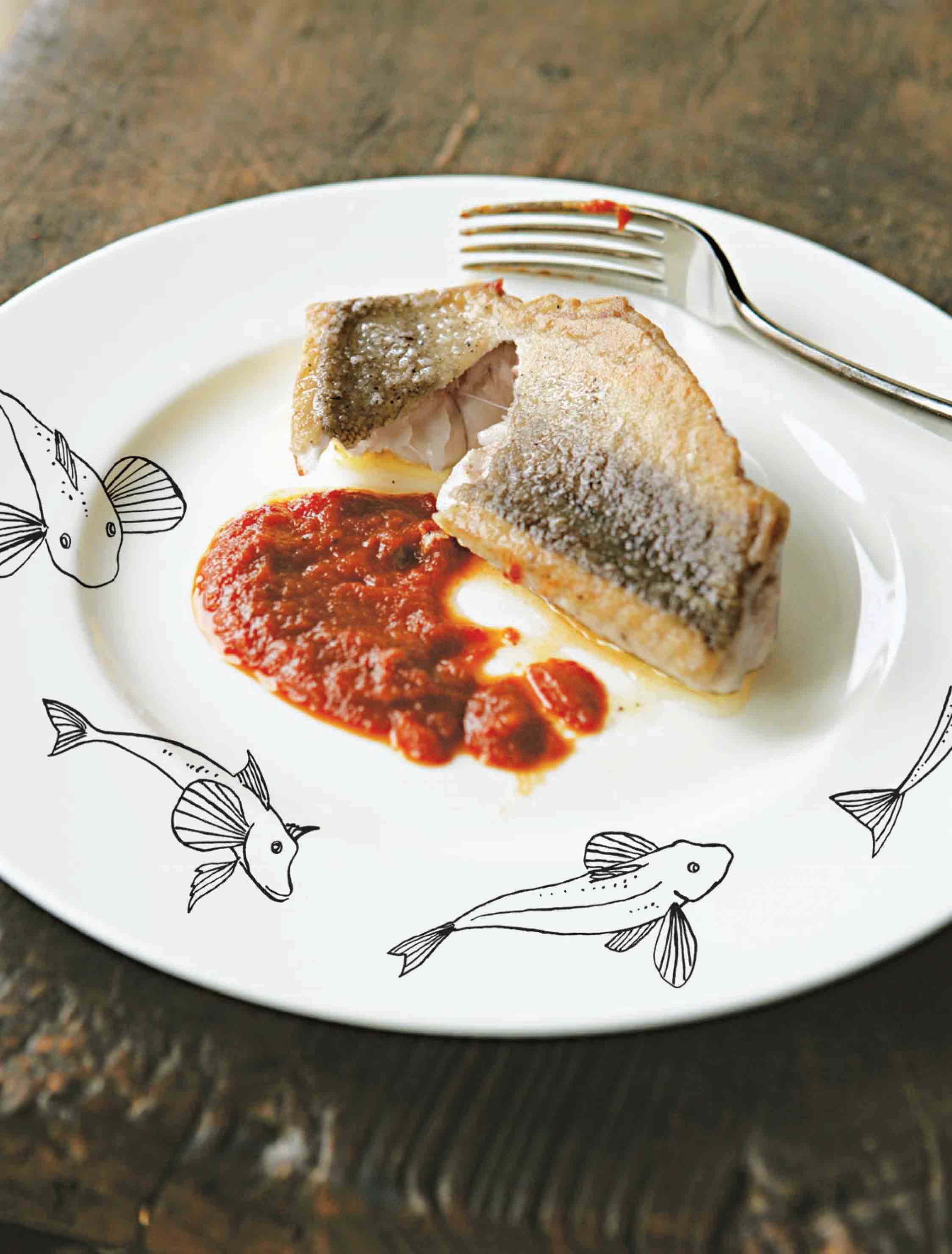 Fried fish fillets with roasted tomato sauce