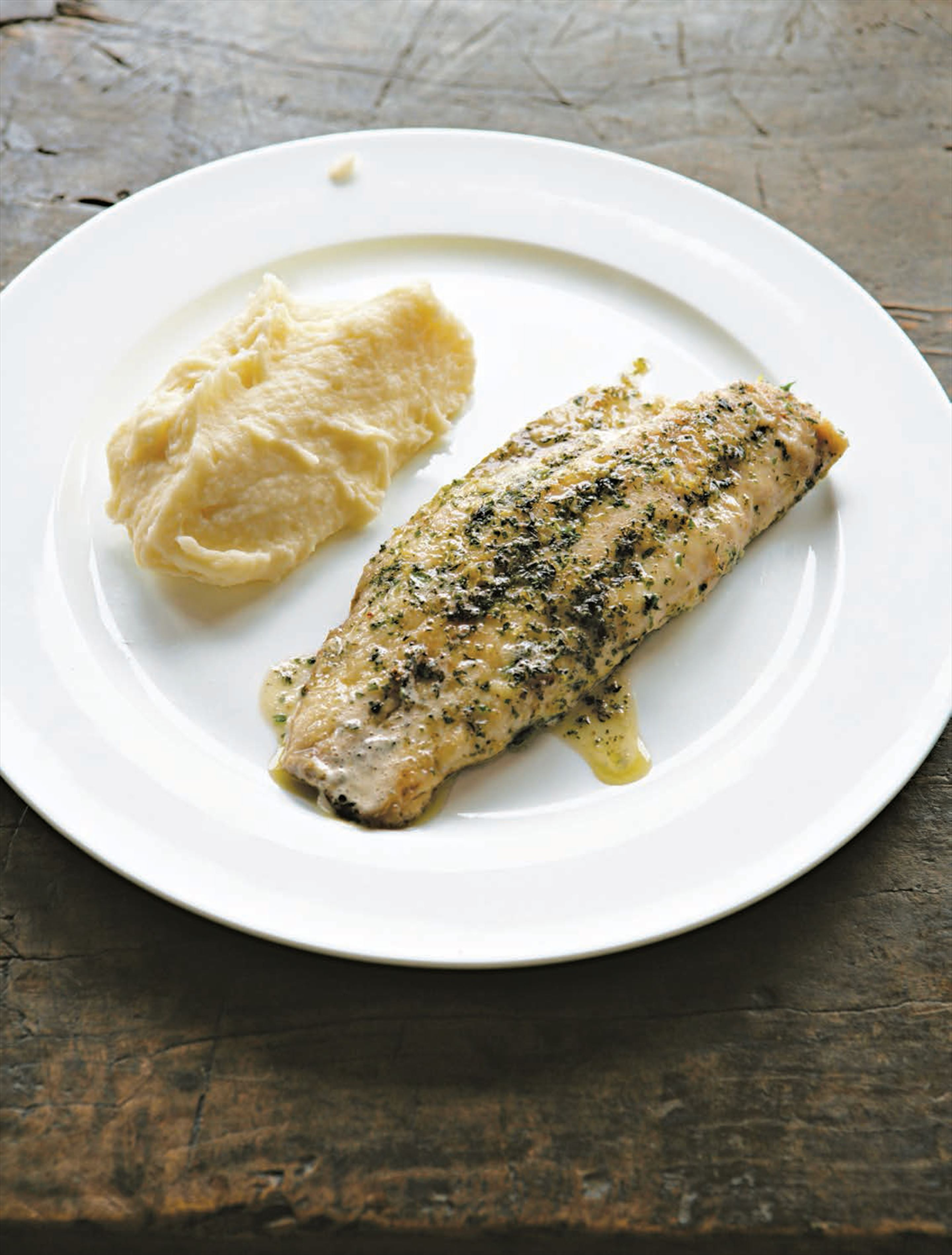 Fried fish fillets with herbs and lemon