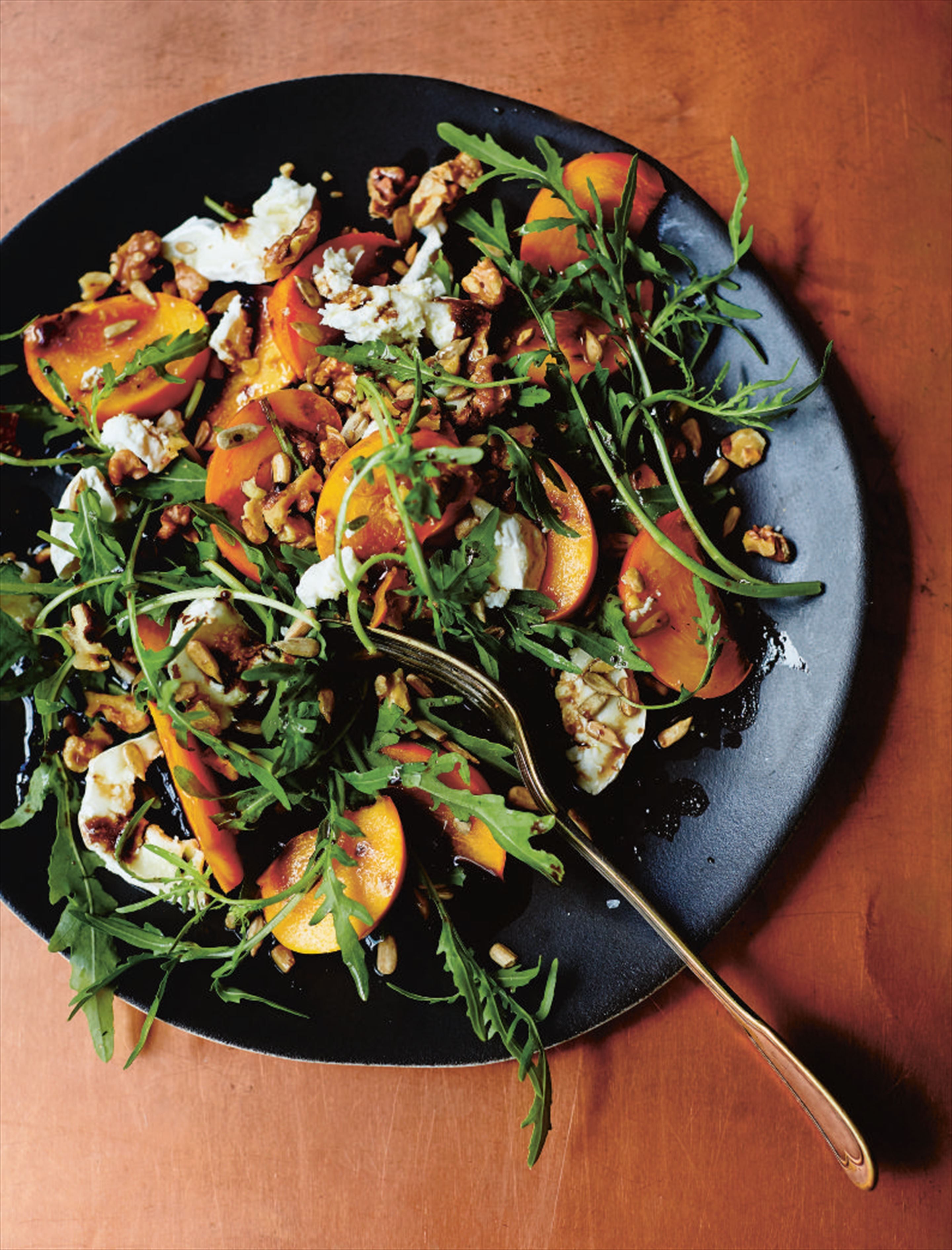 Persimmon, goat's cheese and rocket salad