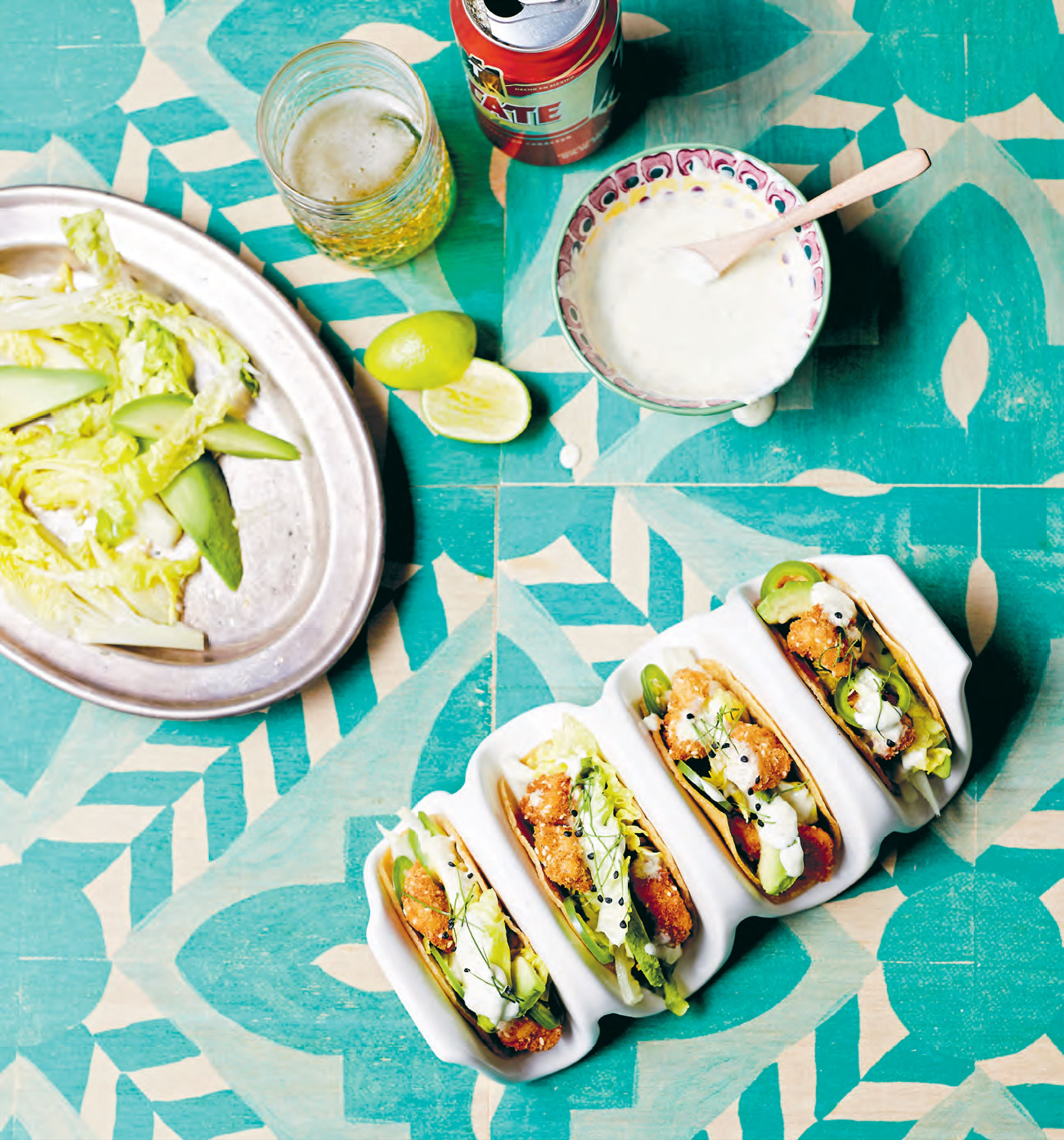 Sesame crunch chicken tacos, cos, avocado & zesty crema