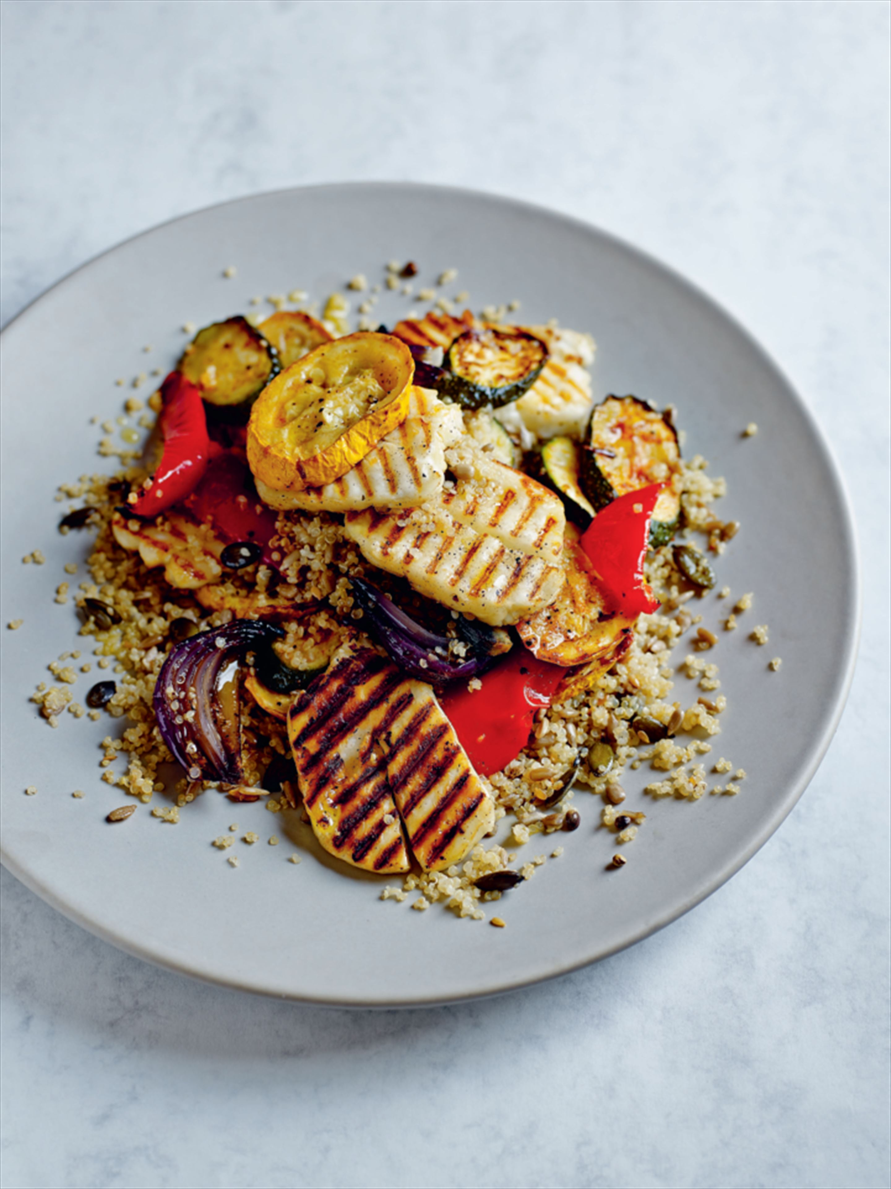 Griddled halloumi with roasted vegetables and seeded quinoa