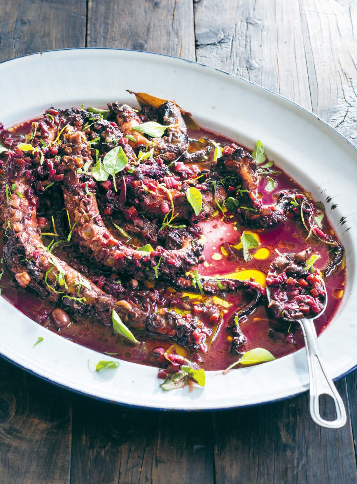 Octopus braised in red wine with lemon and oregano