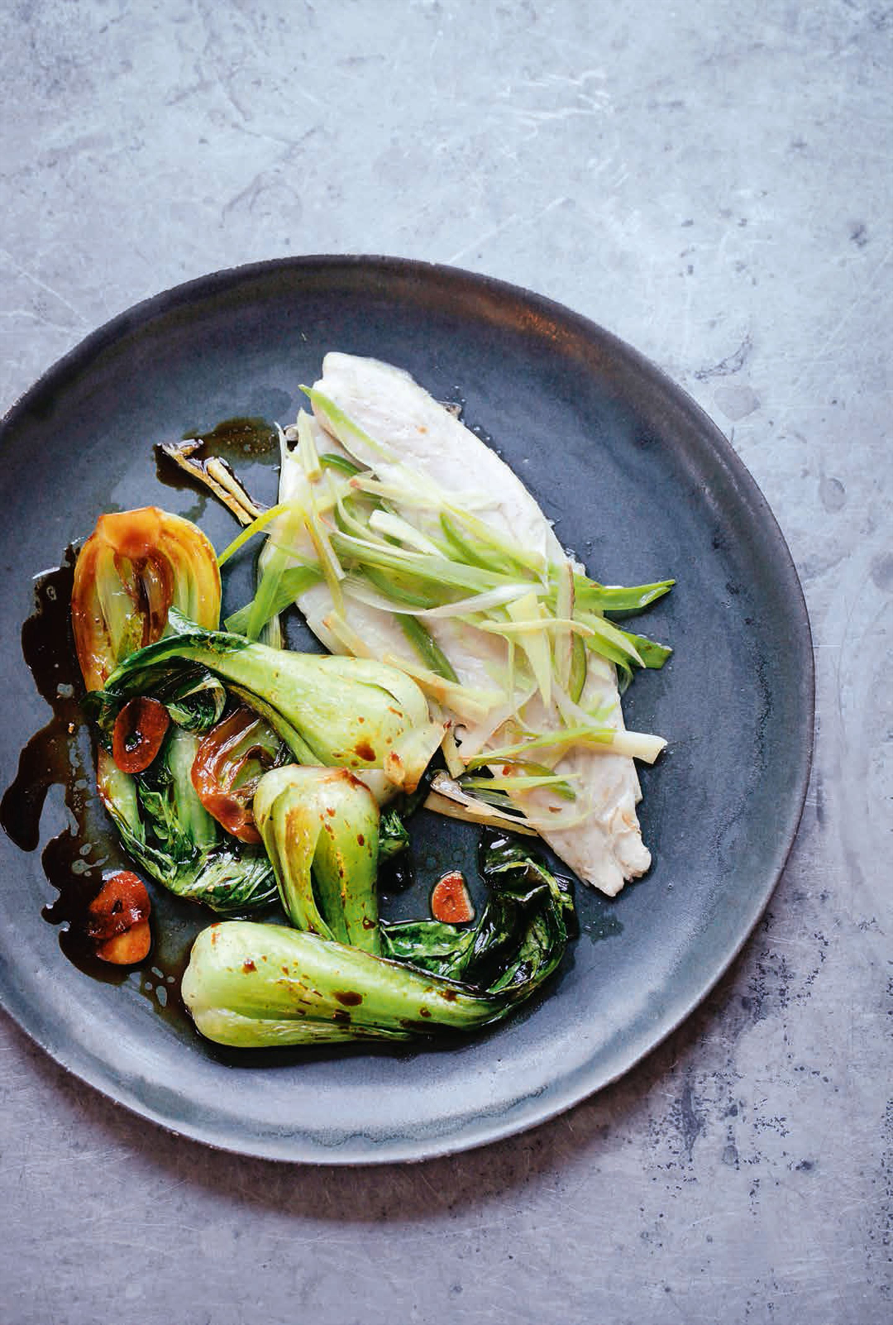 Steamed sea bass with ginger & green chilli, with pak choi