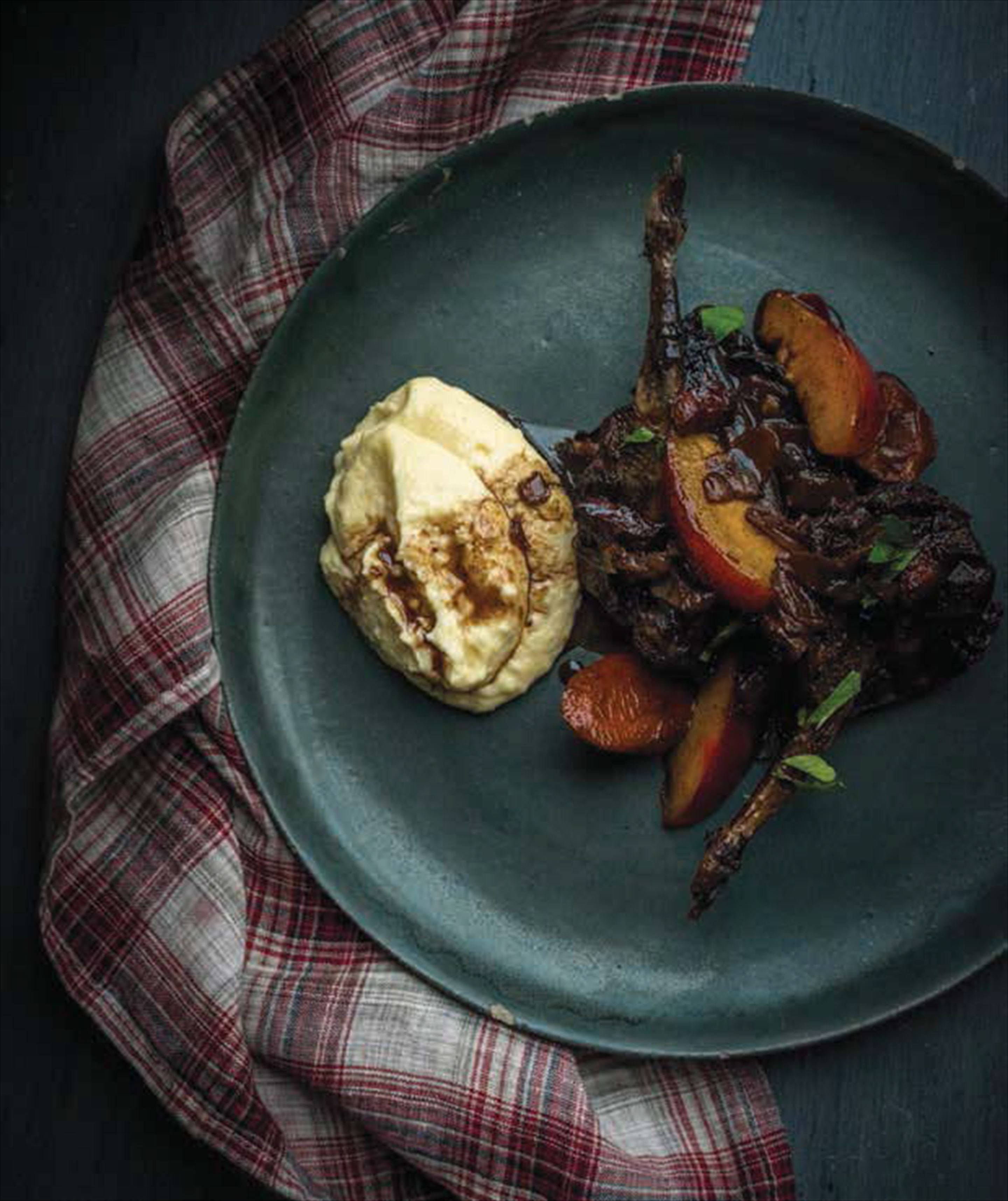 Wood pigeons and plums cooked in red wine with soft polenta