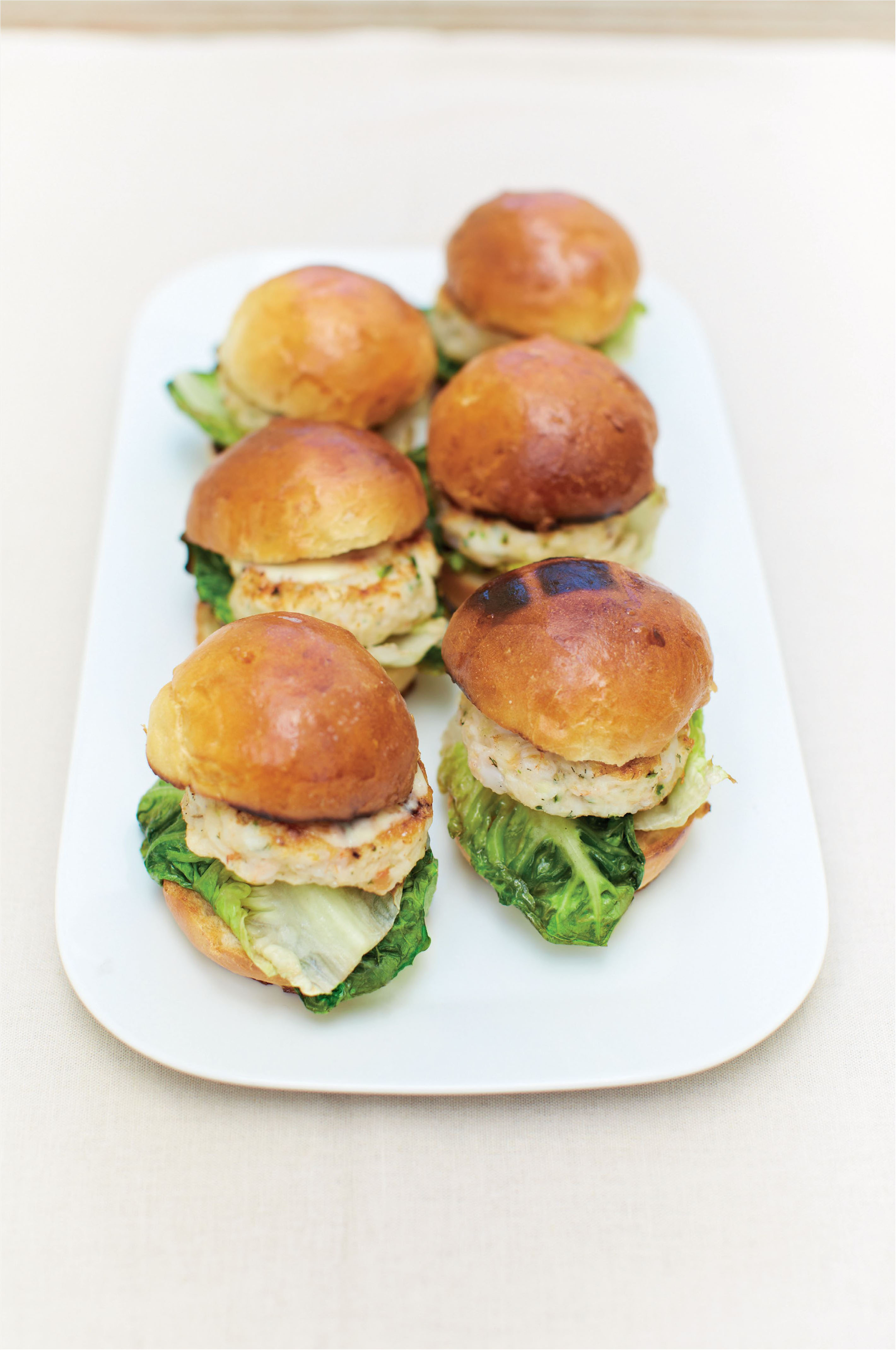 Seafood burger with charred baby gem and wasabi mayonnaise